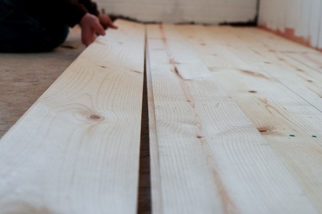 DIY Shiplap Pine Wood Floors with a whitewash. Beautiful, budget friendly flooring!