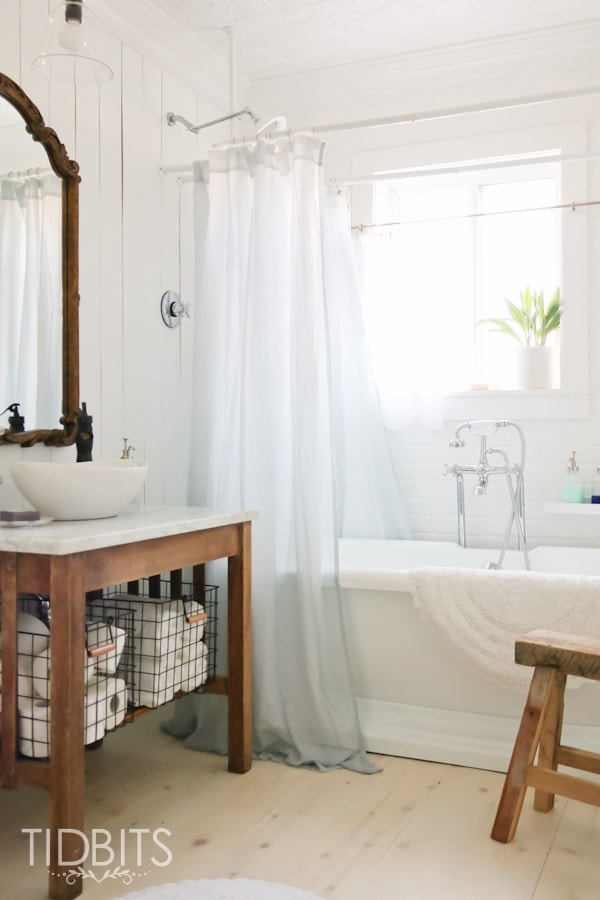 Cottage Bathroom makeover by TIDBITS. A dull and dingy bathroom gets a complete gut job