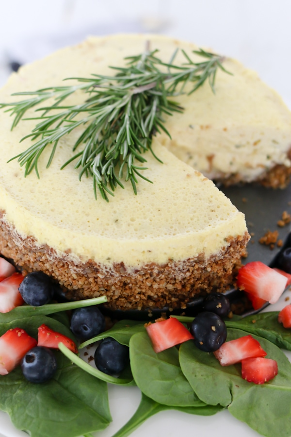 Cheesecake for dinner?! Enjoy this savory blue cheese cheesecake on top of a strawberry spinach salad and drizzled with a sweet balsamic vinaigrette.