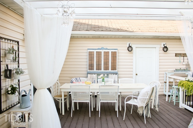 Outdoor dining and furniture for a deck.  Deck makeover by TIDBITS.