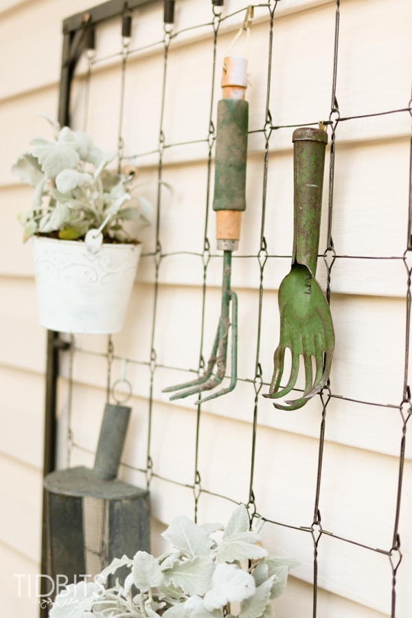 Repurposed crib spring. Used as a garden center and deck decor.