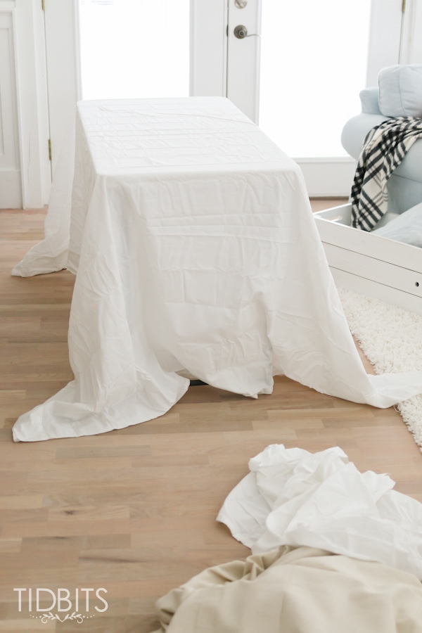 DIY Ruffle Tablecloth from cotton sheets - turn your inexpensive fold up tables into lovely accent tables.