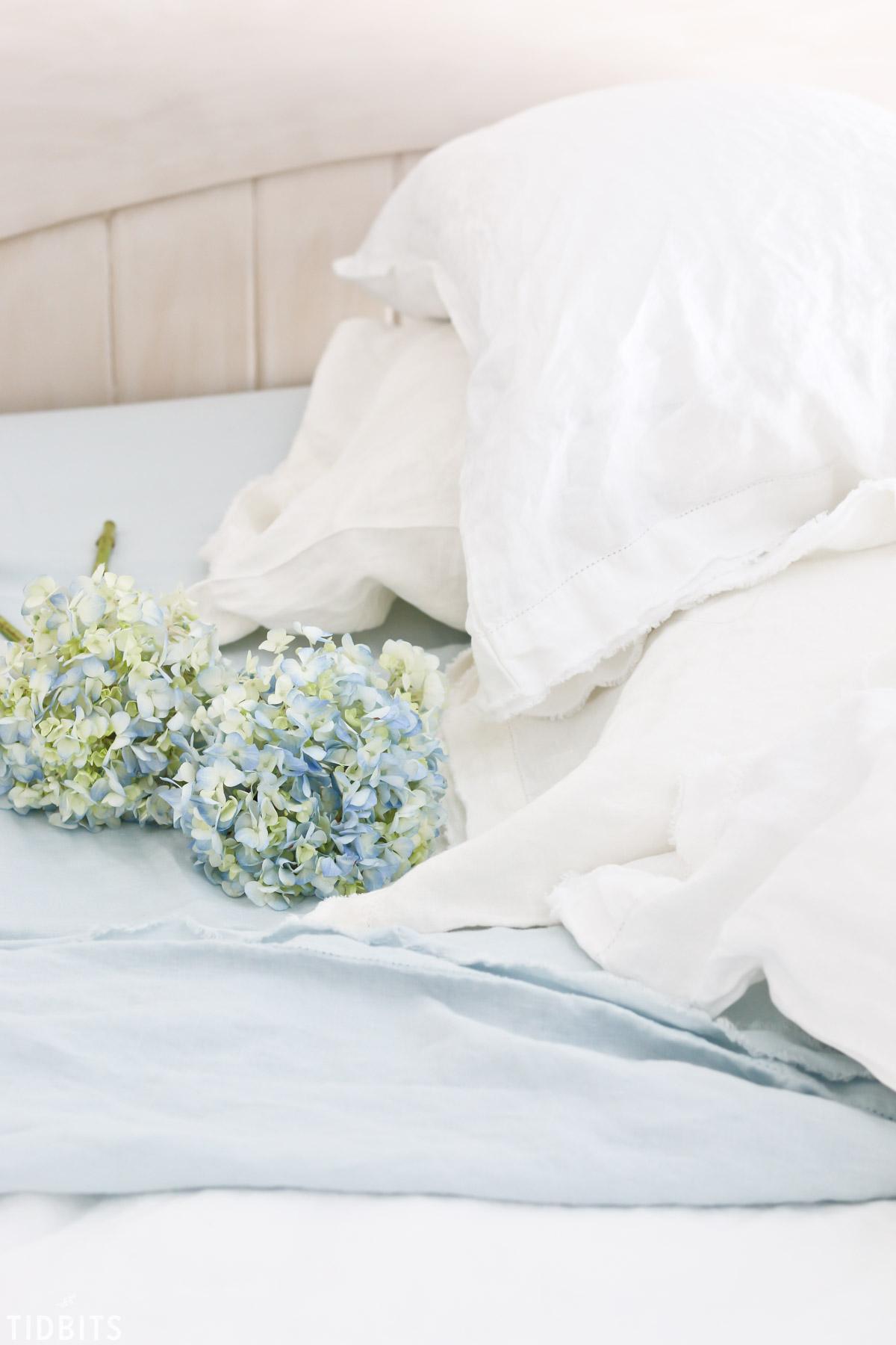 soft blue hydrangeas and linen sheets