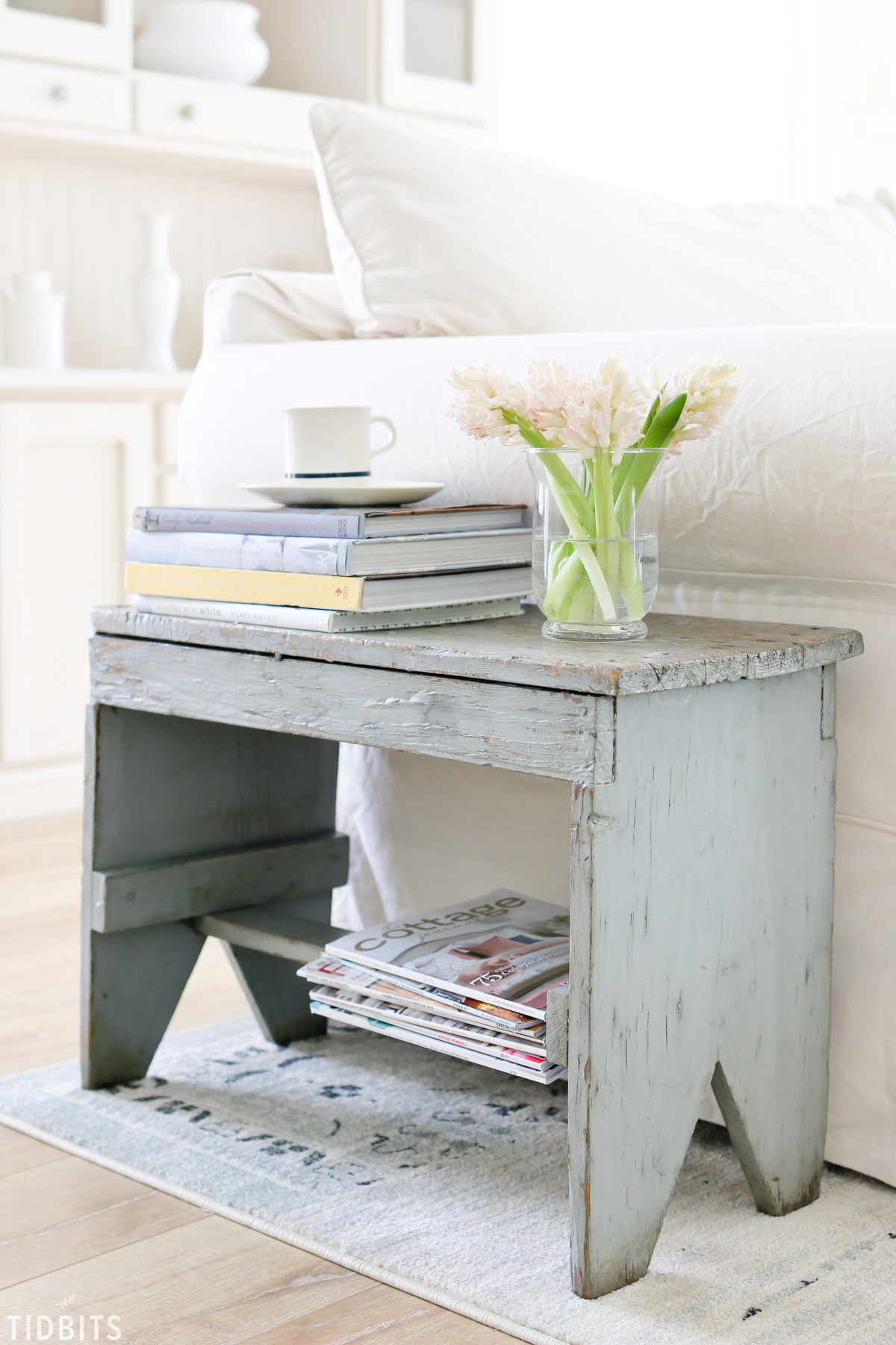 Bench used as a side table for magazines