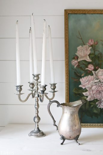 candelabra next to vintage French style pitcher