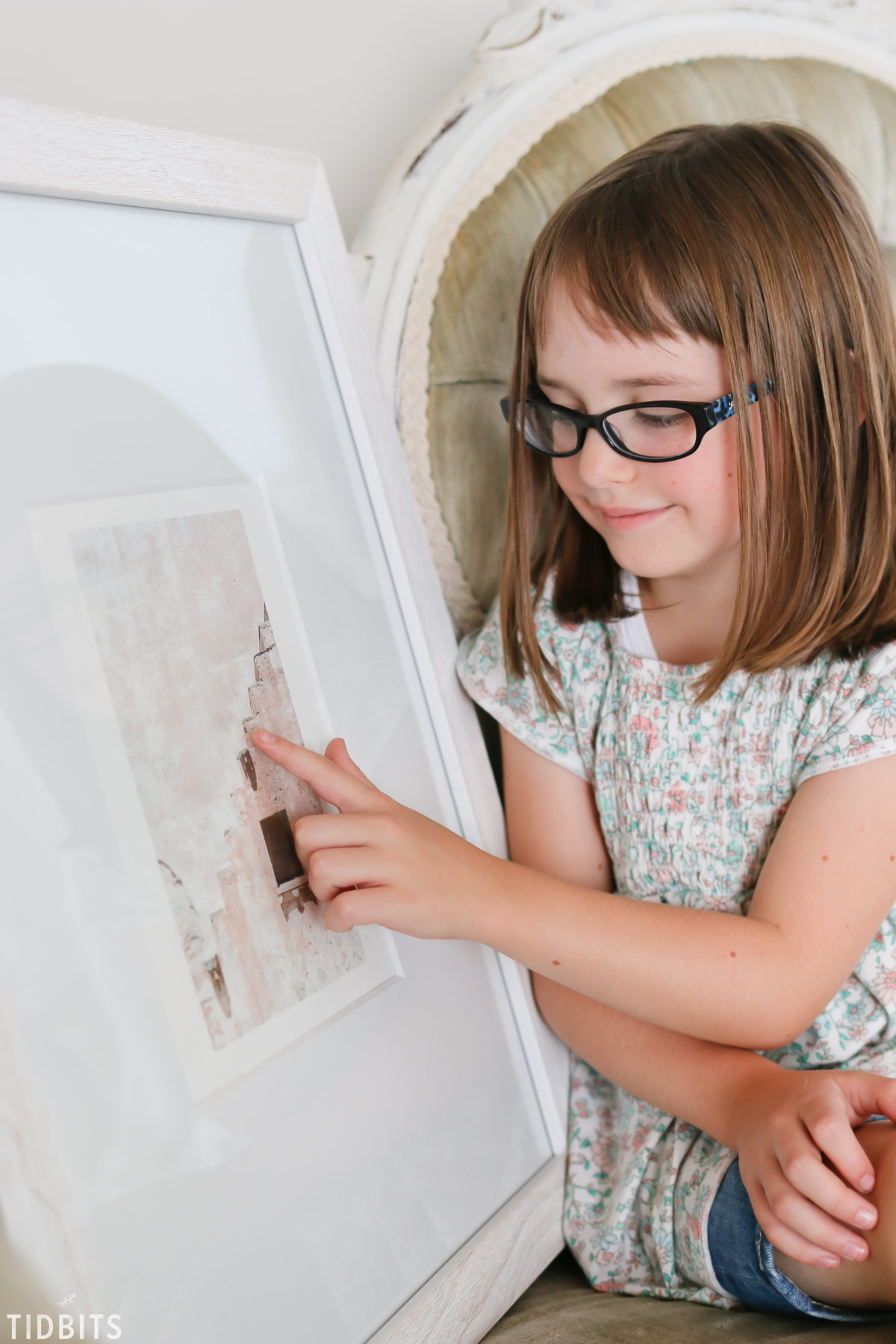girl exploring wall art