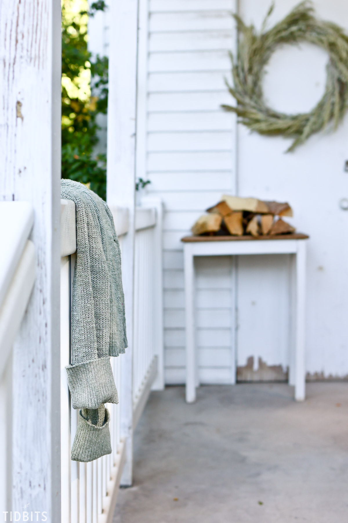 cozy sweater on a fall front porch