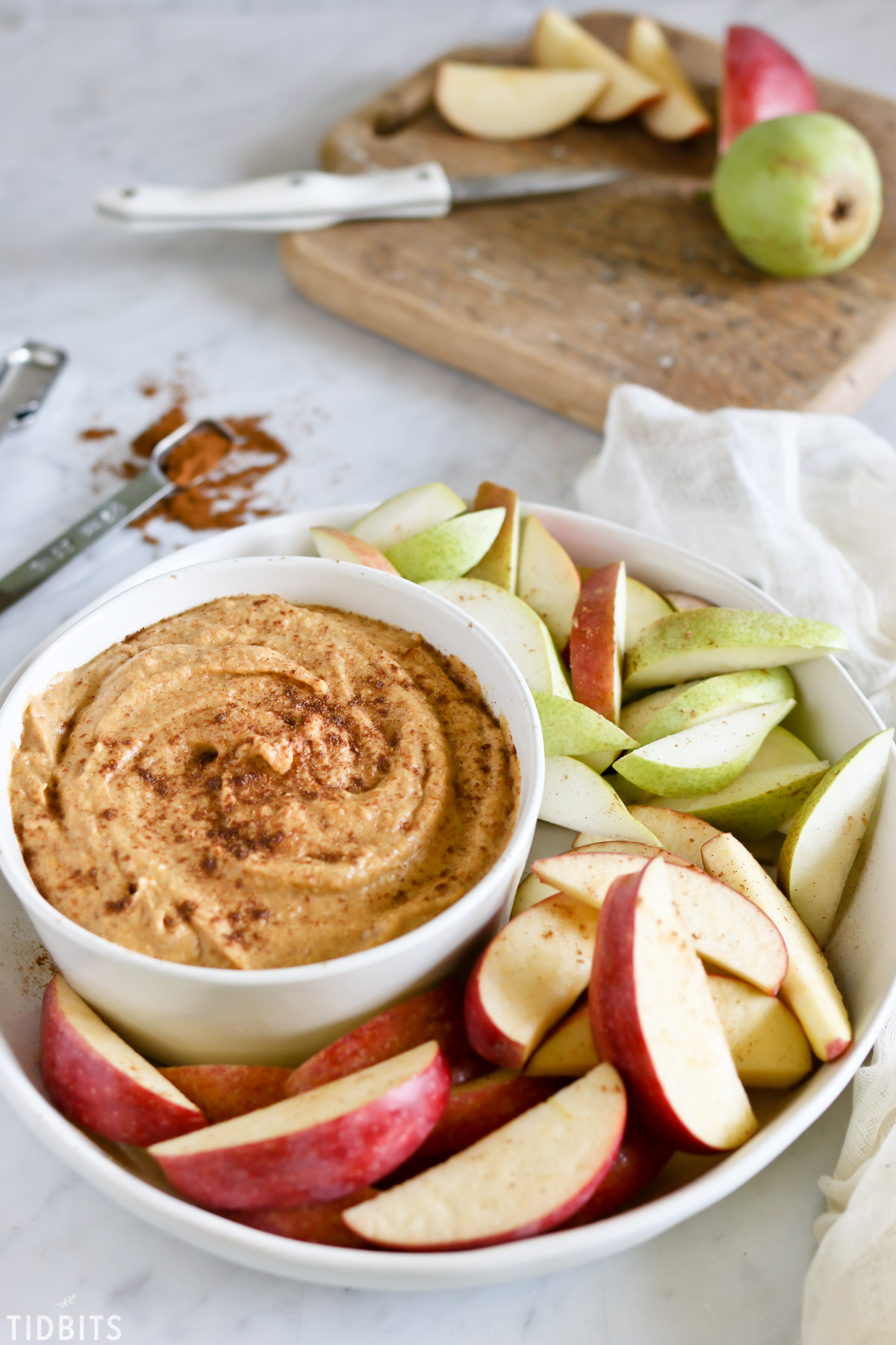 Healthy pumpkin dip with apples for dipping.