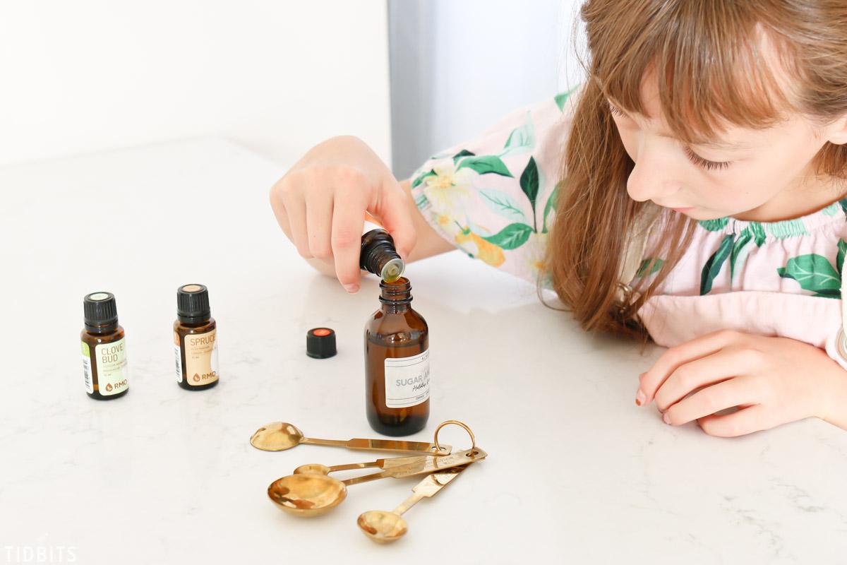 adding essential oils to holiday room spray