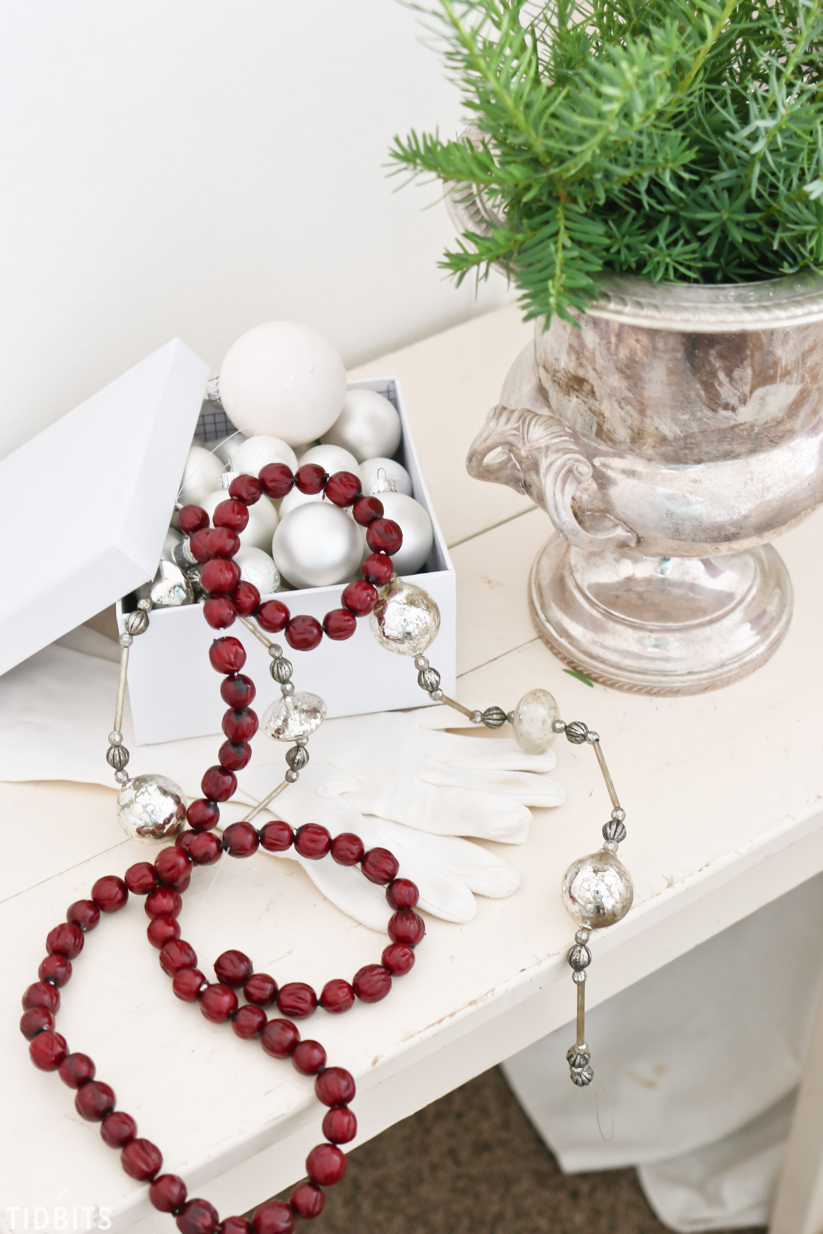 red cranberries on string, silver ornaments.