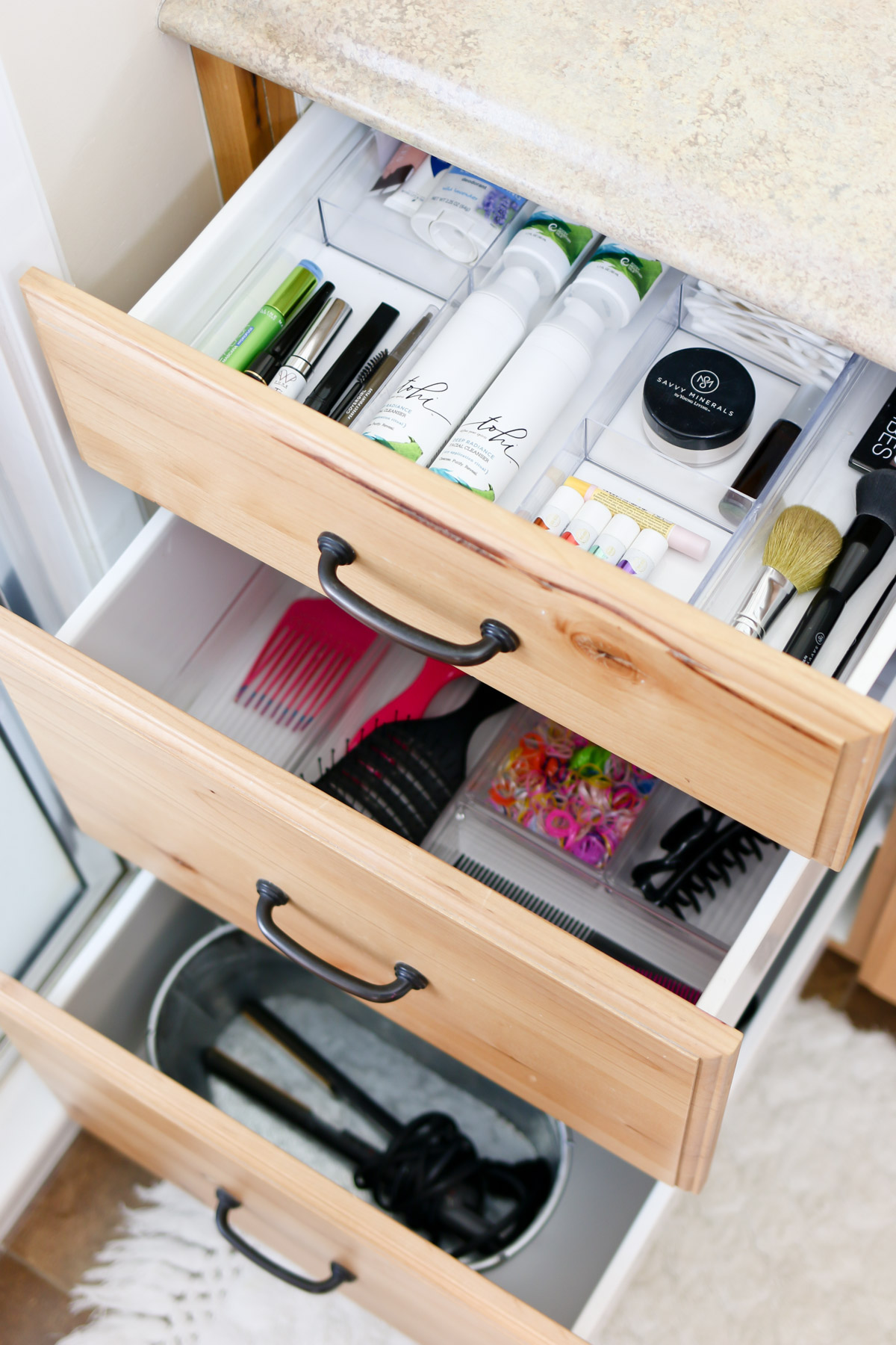Supplies, tips and ideas for organizing bathroom drawers and cupboards.