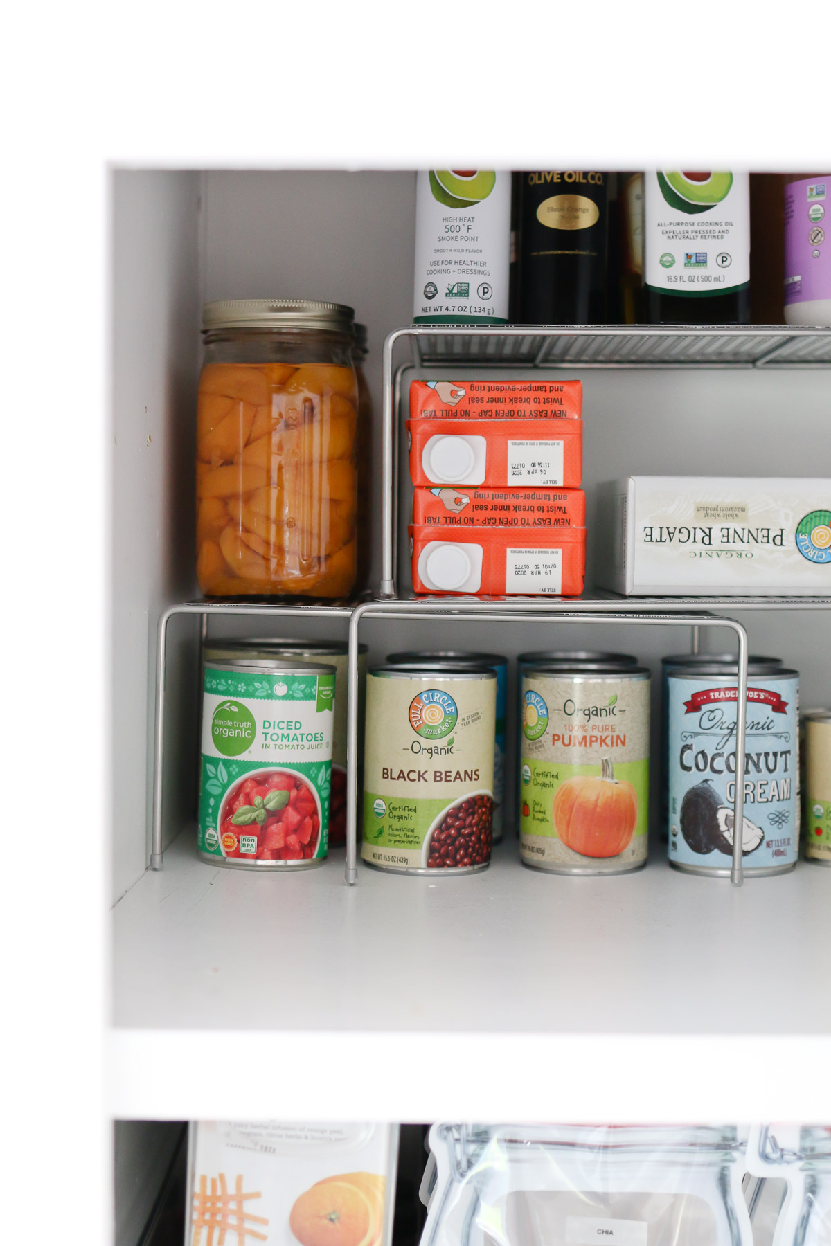 Use stacking shelf risers to organize a small pantry and make the most of all your space.