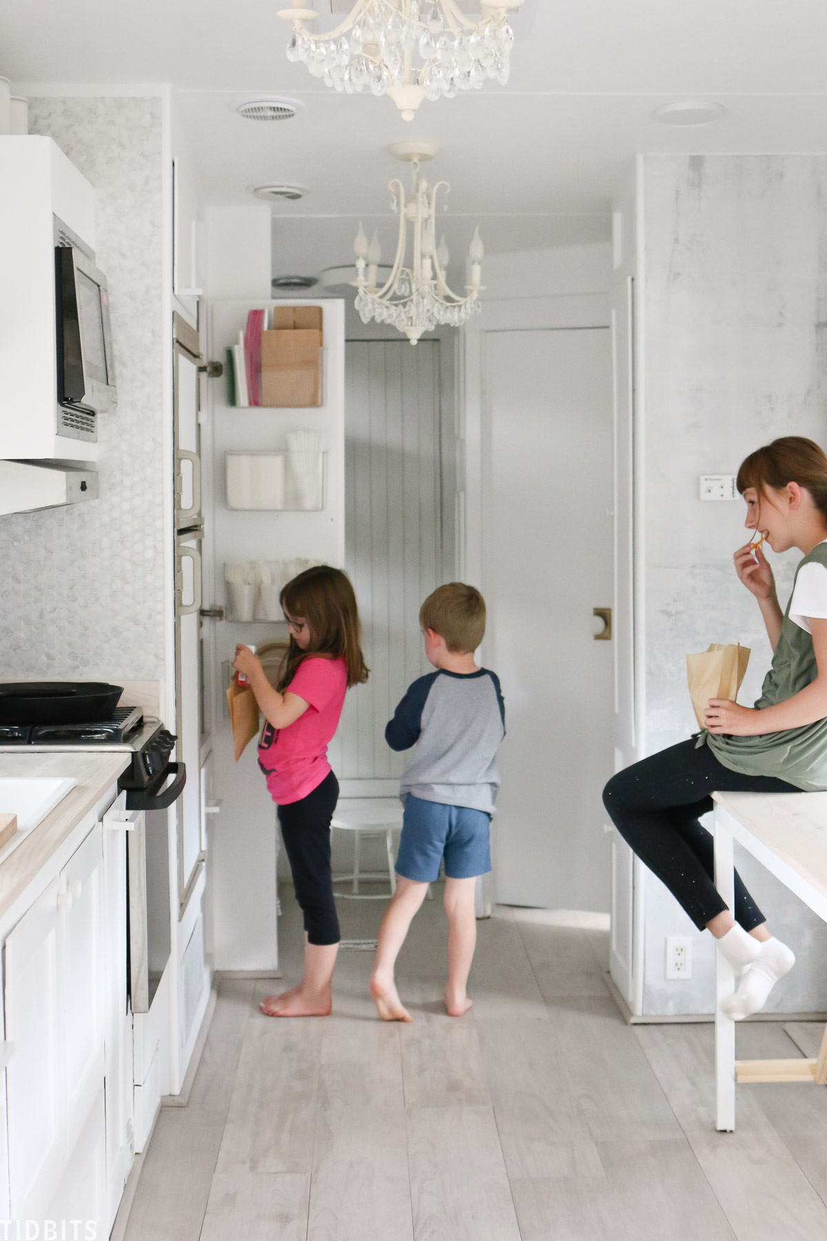Family of 6 living with a tiny pantry in an RV and giving storage solutions.
