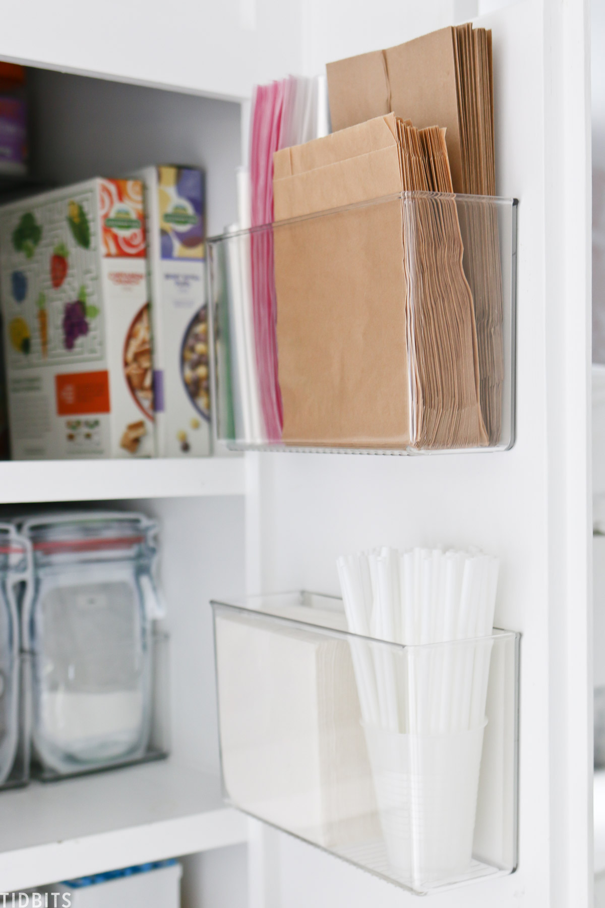 Storing paper products on the cabinet door fronts
