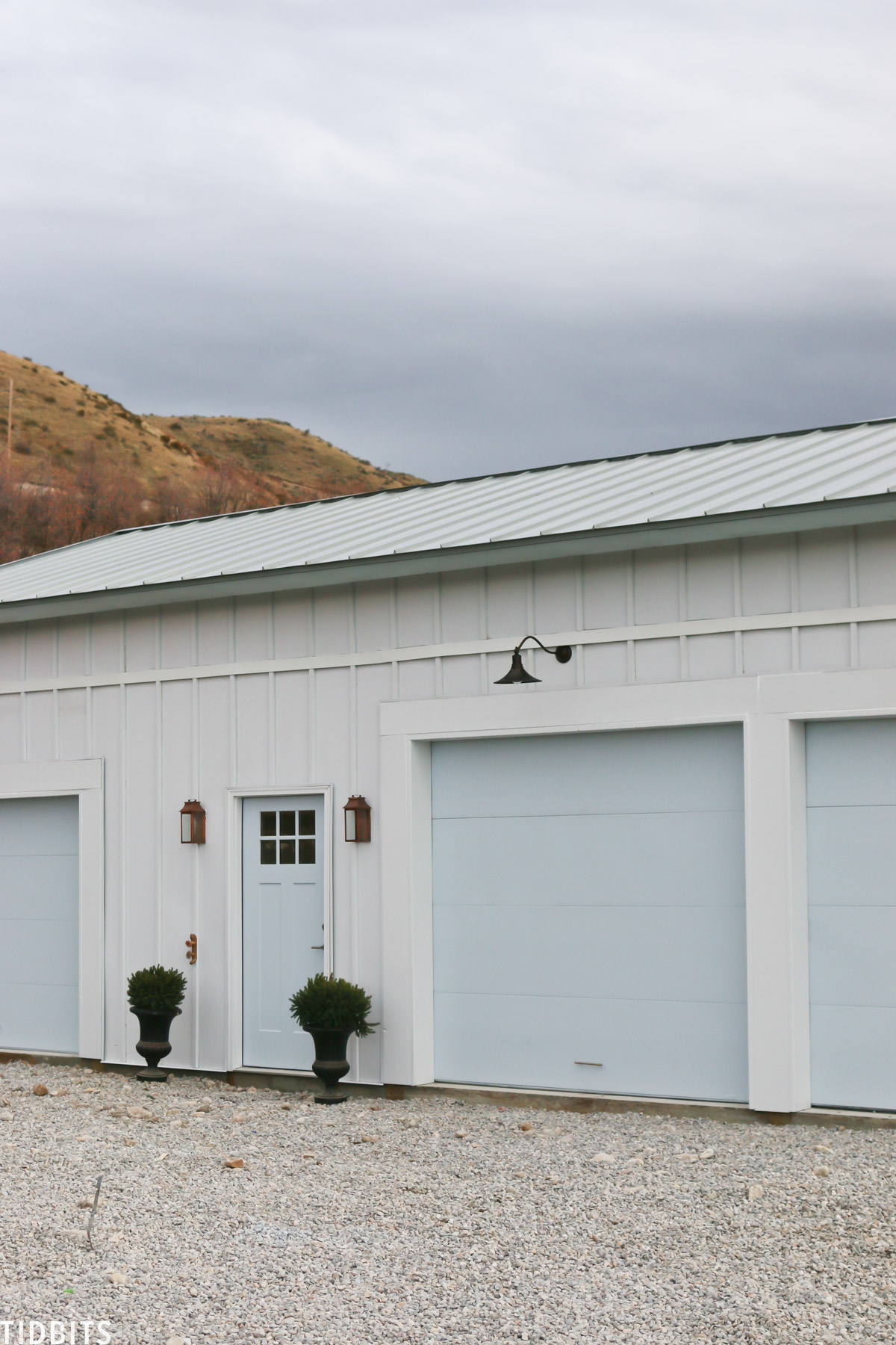 Painted garage doors, steel siding and roofing, pole barn home.