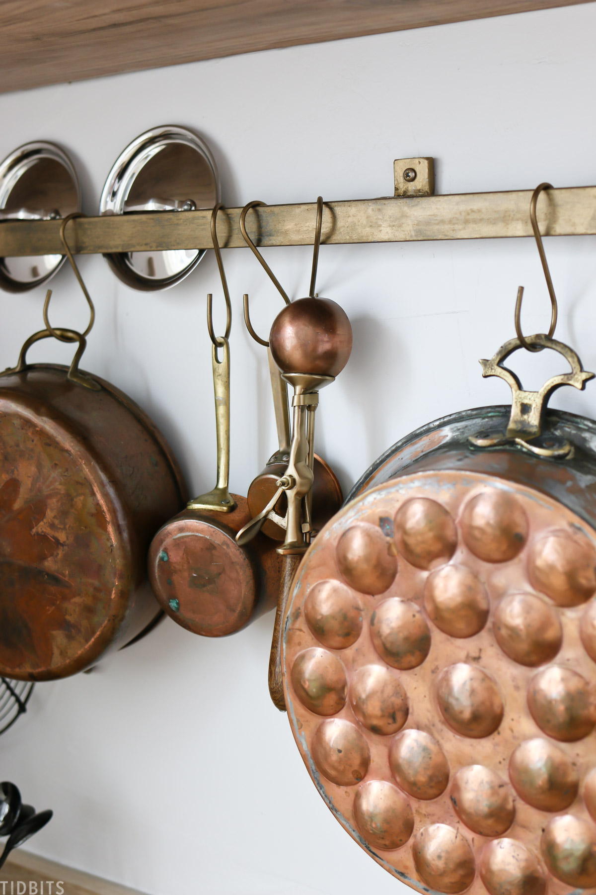 utensil rod with pretty copper kitchen items