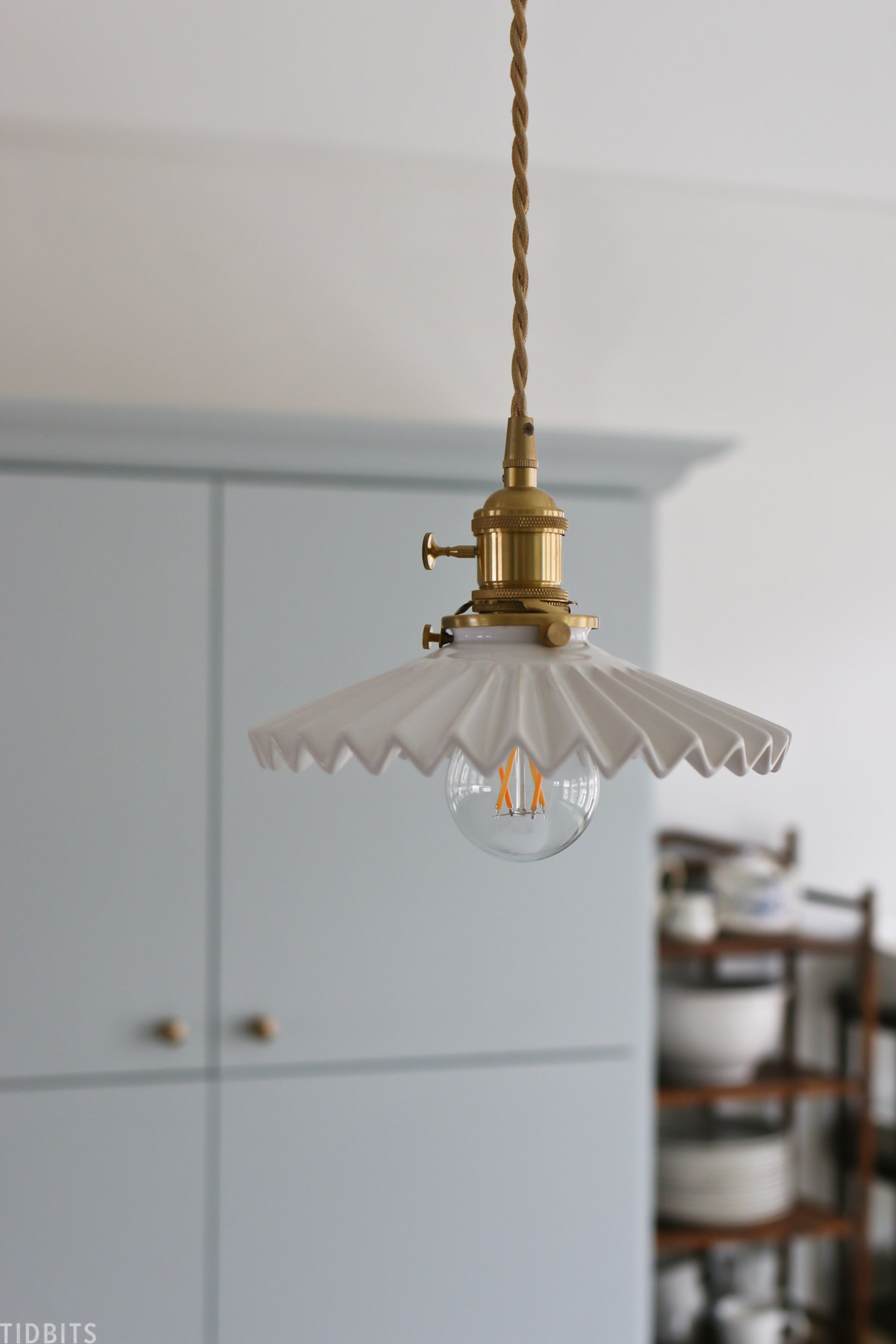 Scalloped light fixture with brass hardware