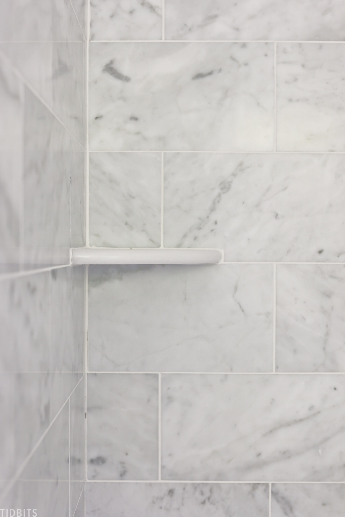 marble shelf in bathroom shower