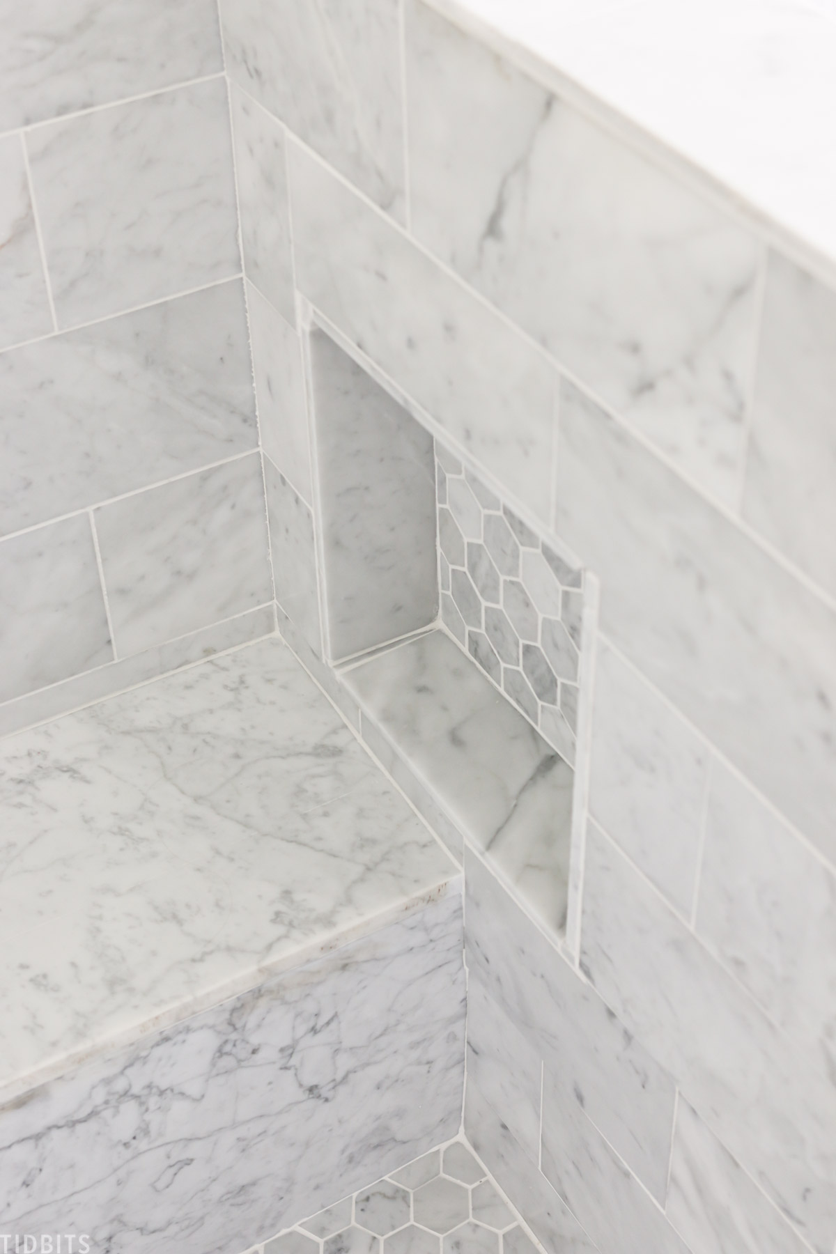 built in shelving in marble shower