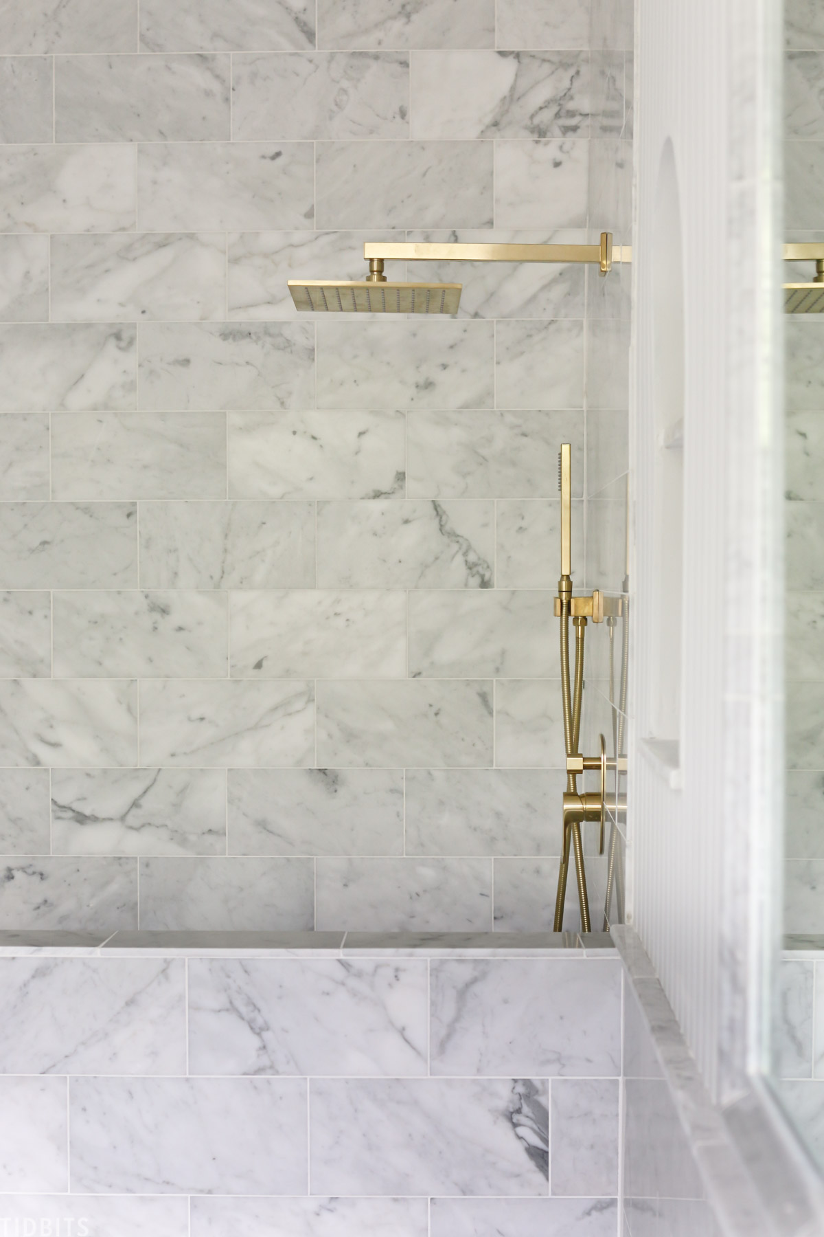 gold fixtures in marble bathroom