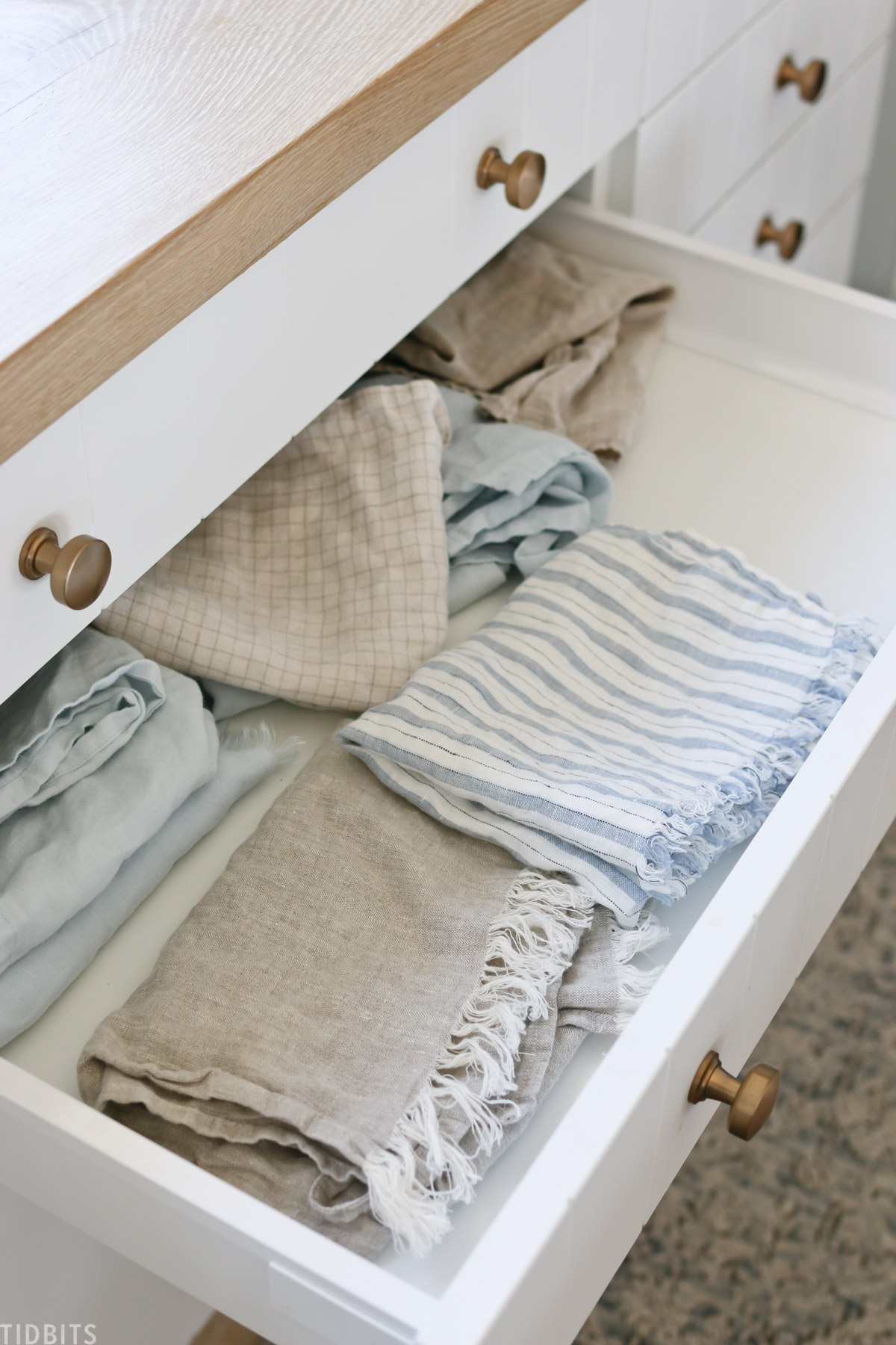 linen tea towels in drawers