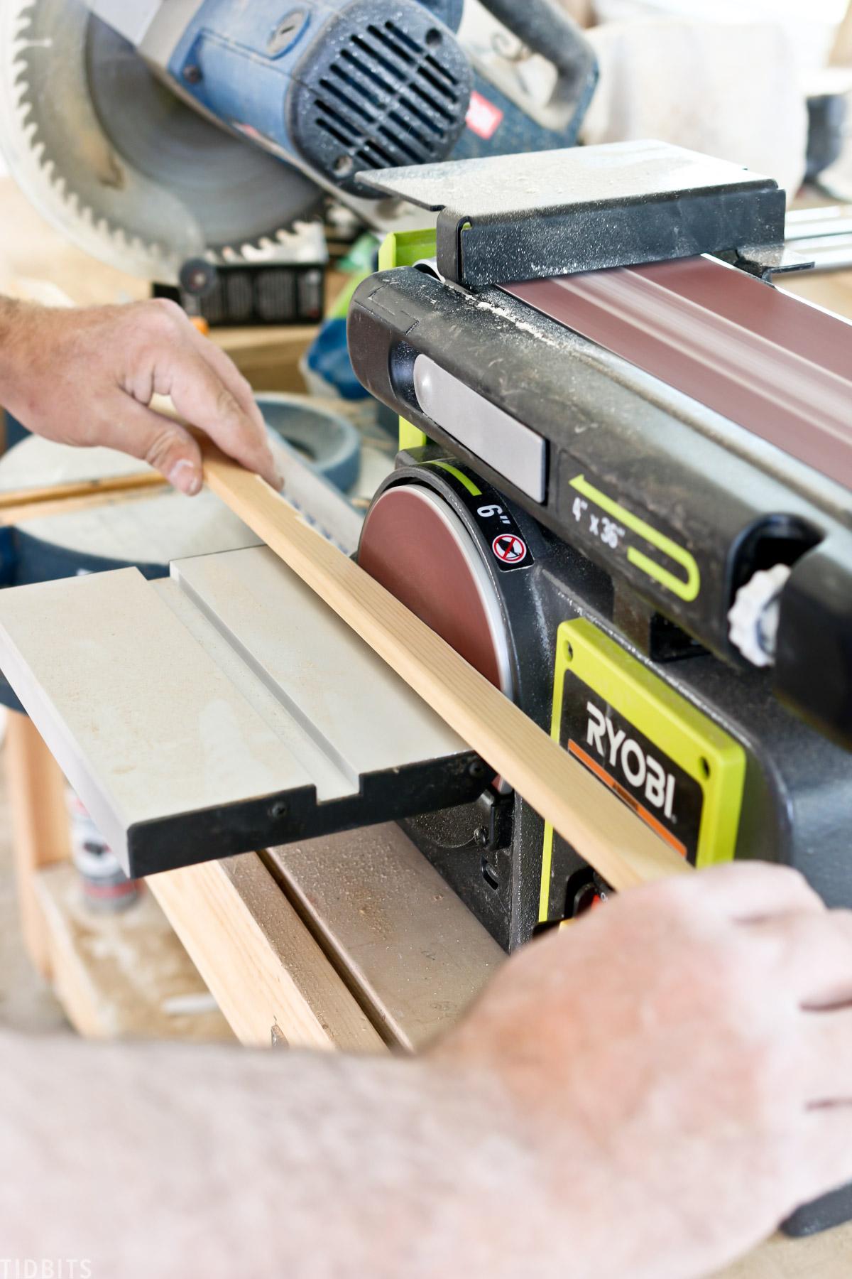 Sanding custom moulding for millwork.