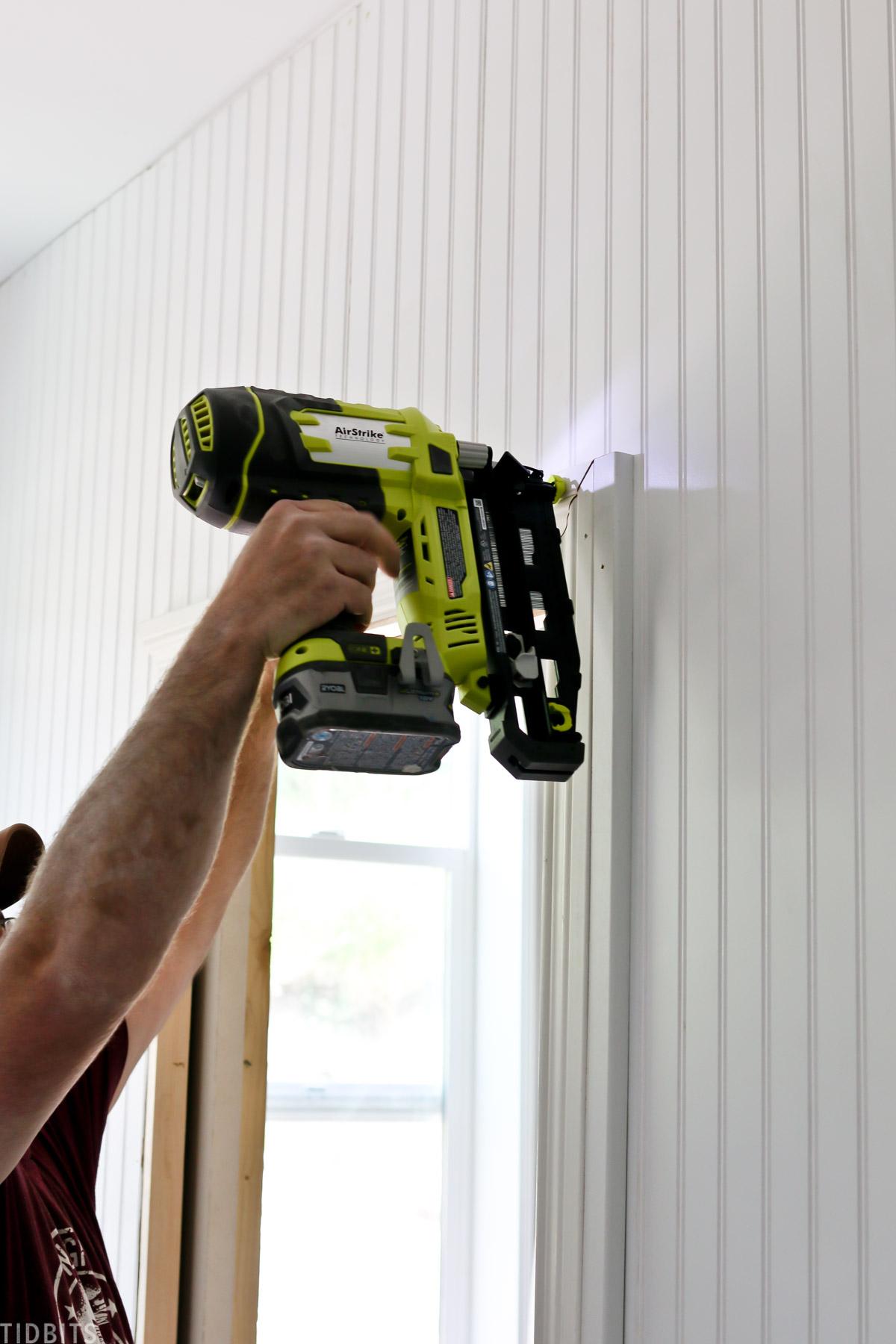 Installing a door casing millwork.