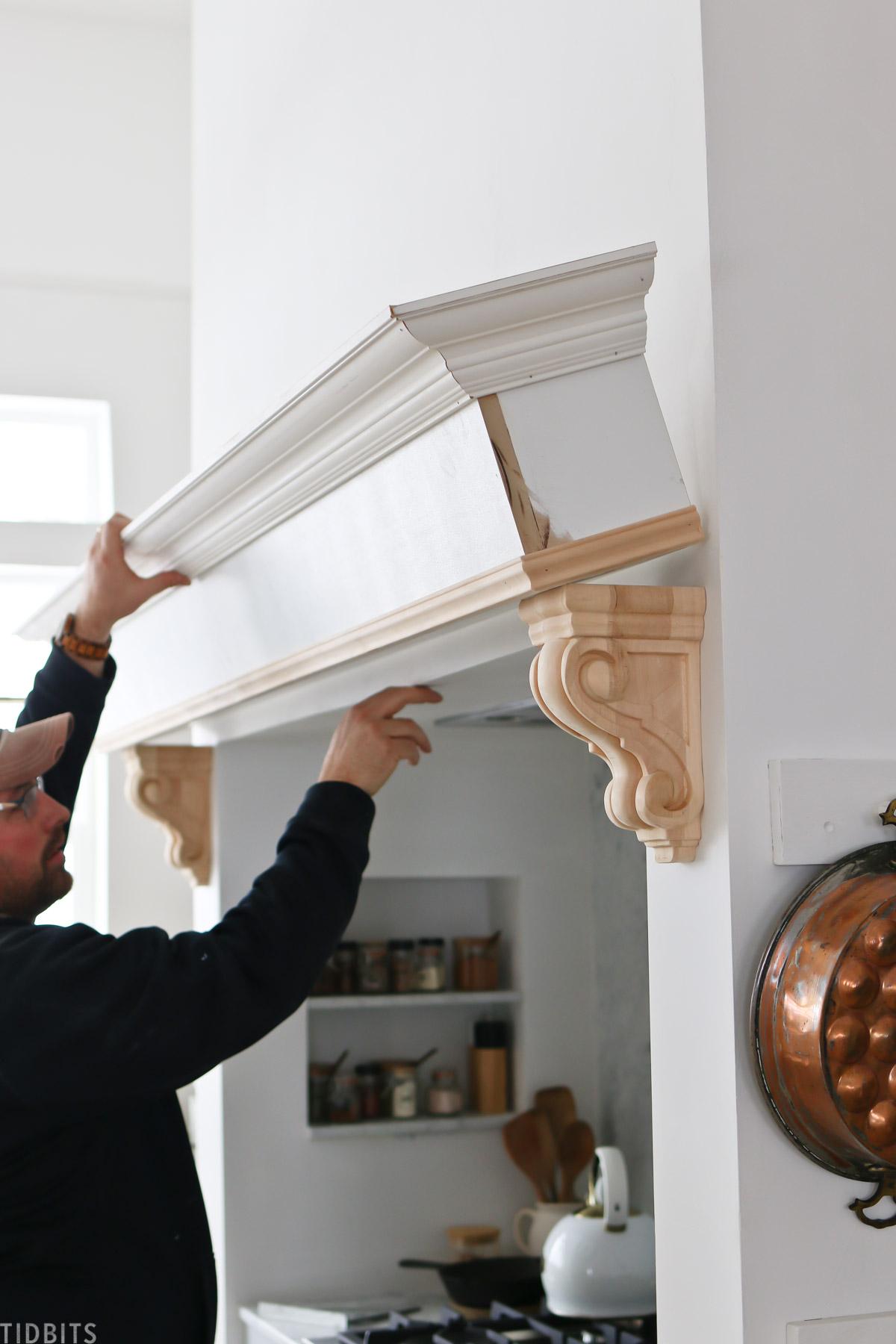 Installing shelf to surround a range hood area.
