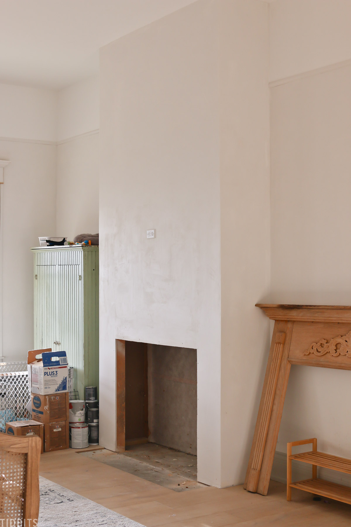 first step creating a faux fireplace showing the cutout in the wall of living room
