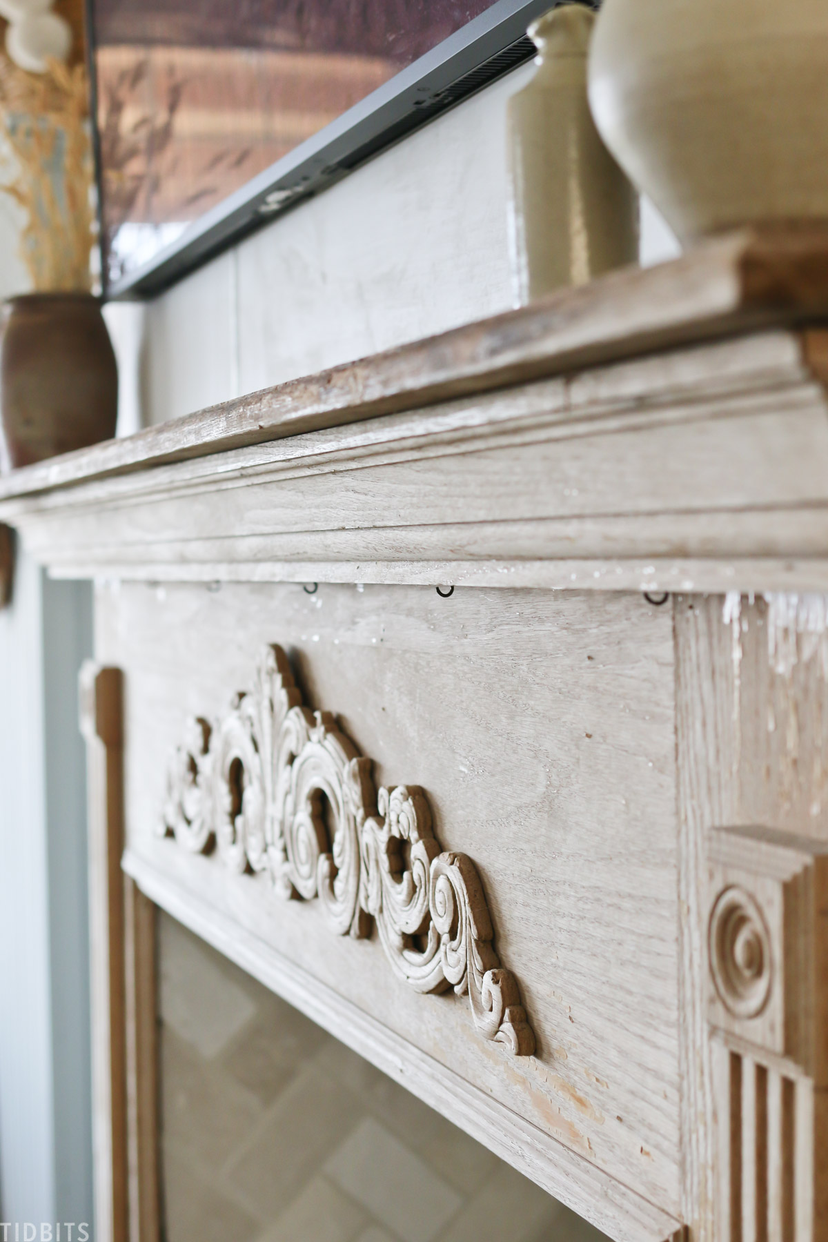 details on wooden faux fireplace mantel