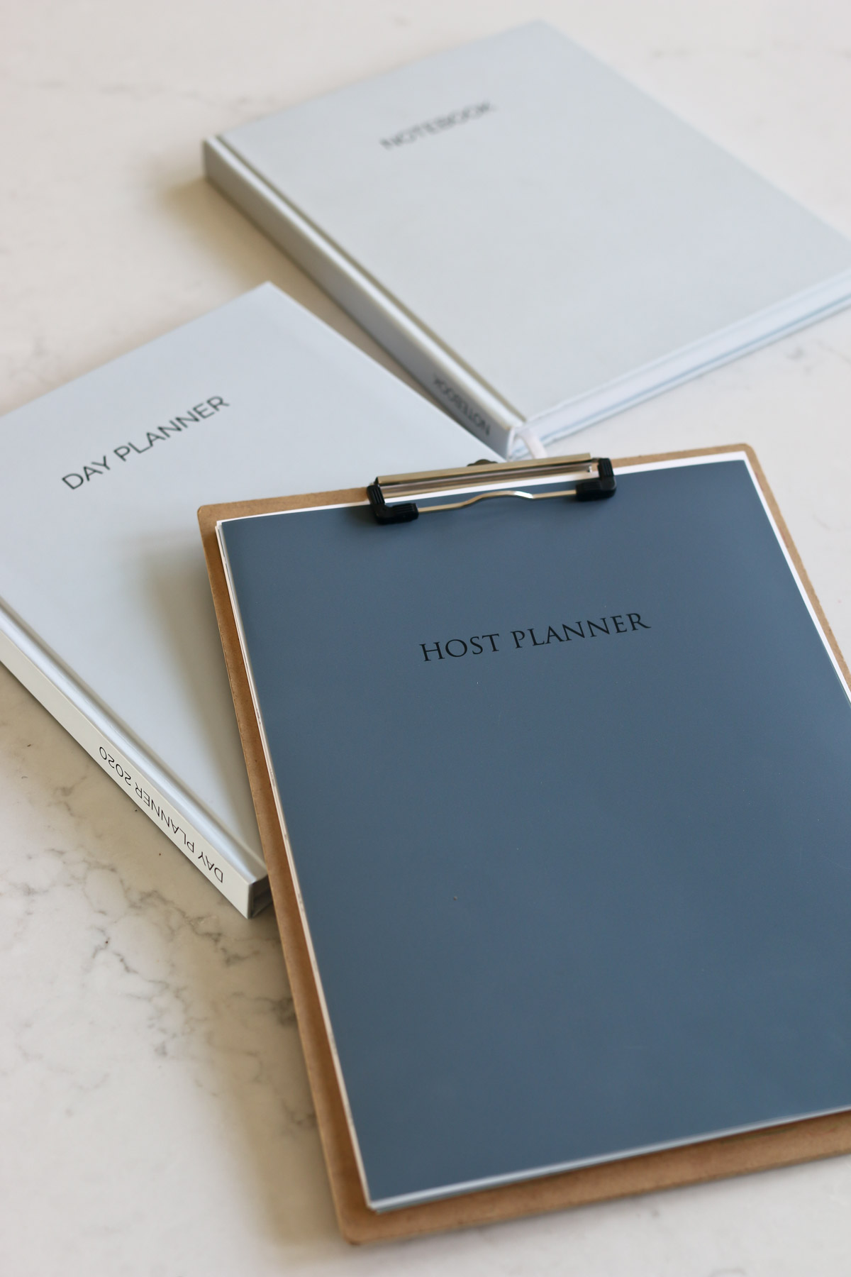 Host Planner pages attached to a clipboard