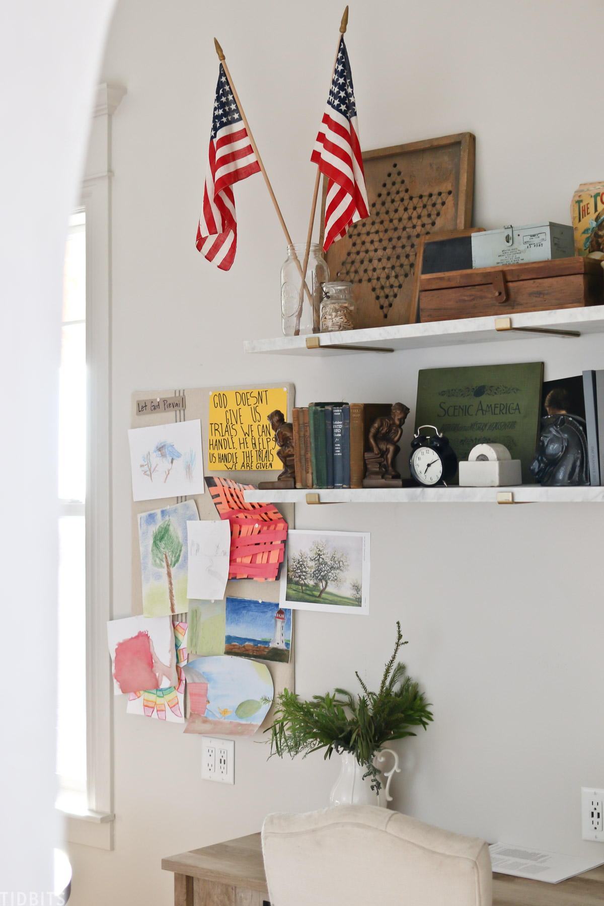 desk with two bookshelves above it containing books and home decor decorations