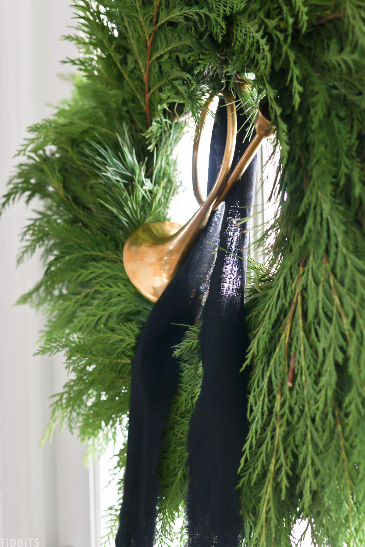 Christmas wreath with black ribbon and decorative horn