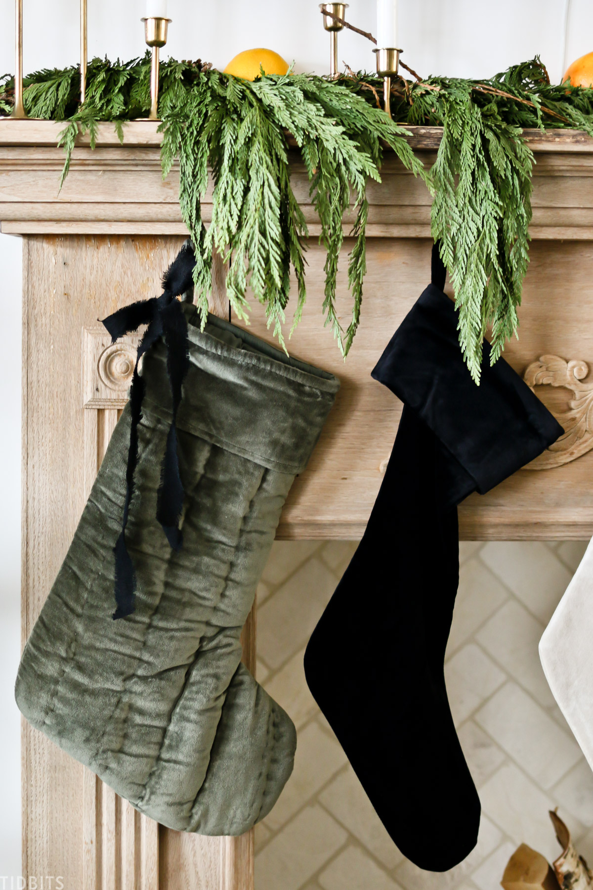 two Christmas stockings hanging from mantel