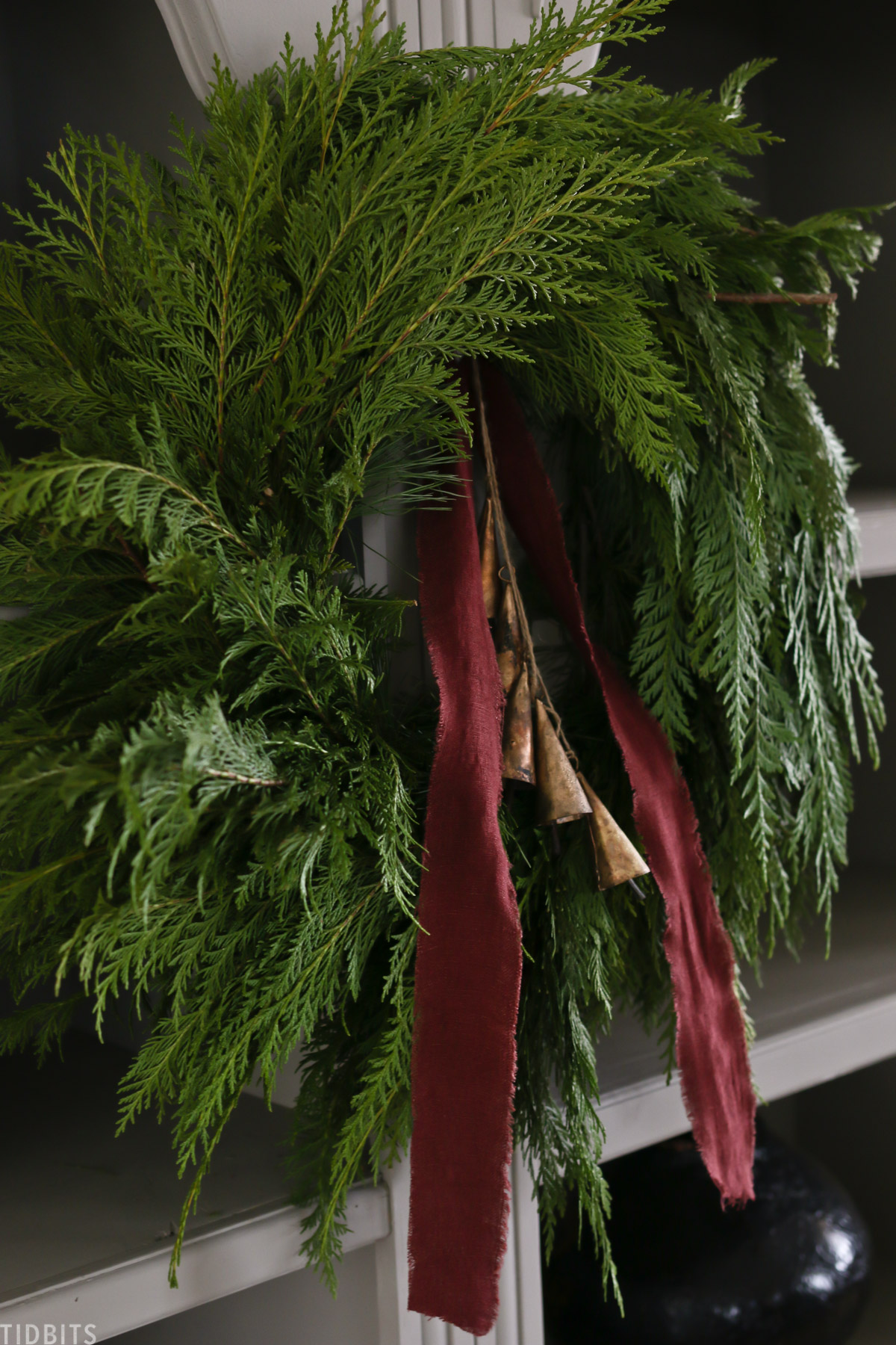 Christmas wreath with red linen ribbon and bells