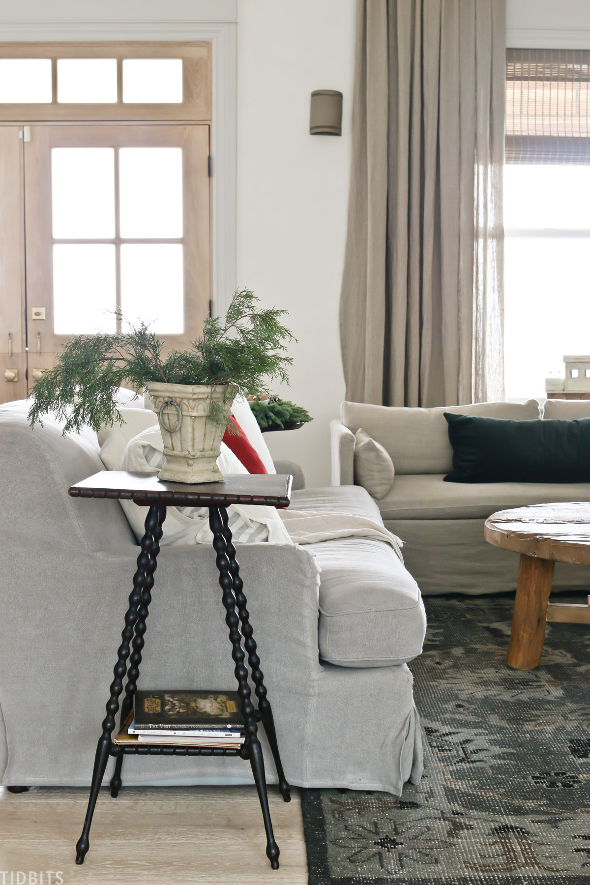 living room with European Old World Christmas decorations with arm chair, coffee table, and two couches