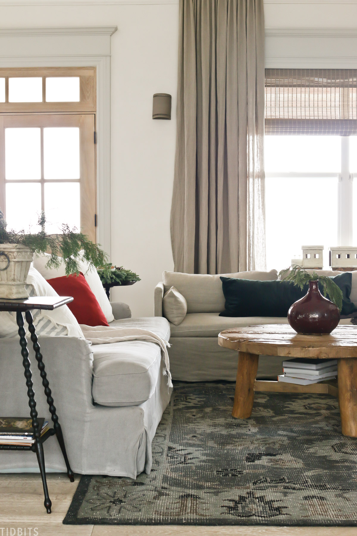 living room with European Old World Christmas decorations with arm chair, coffee table, and couch