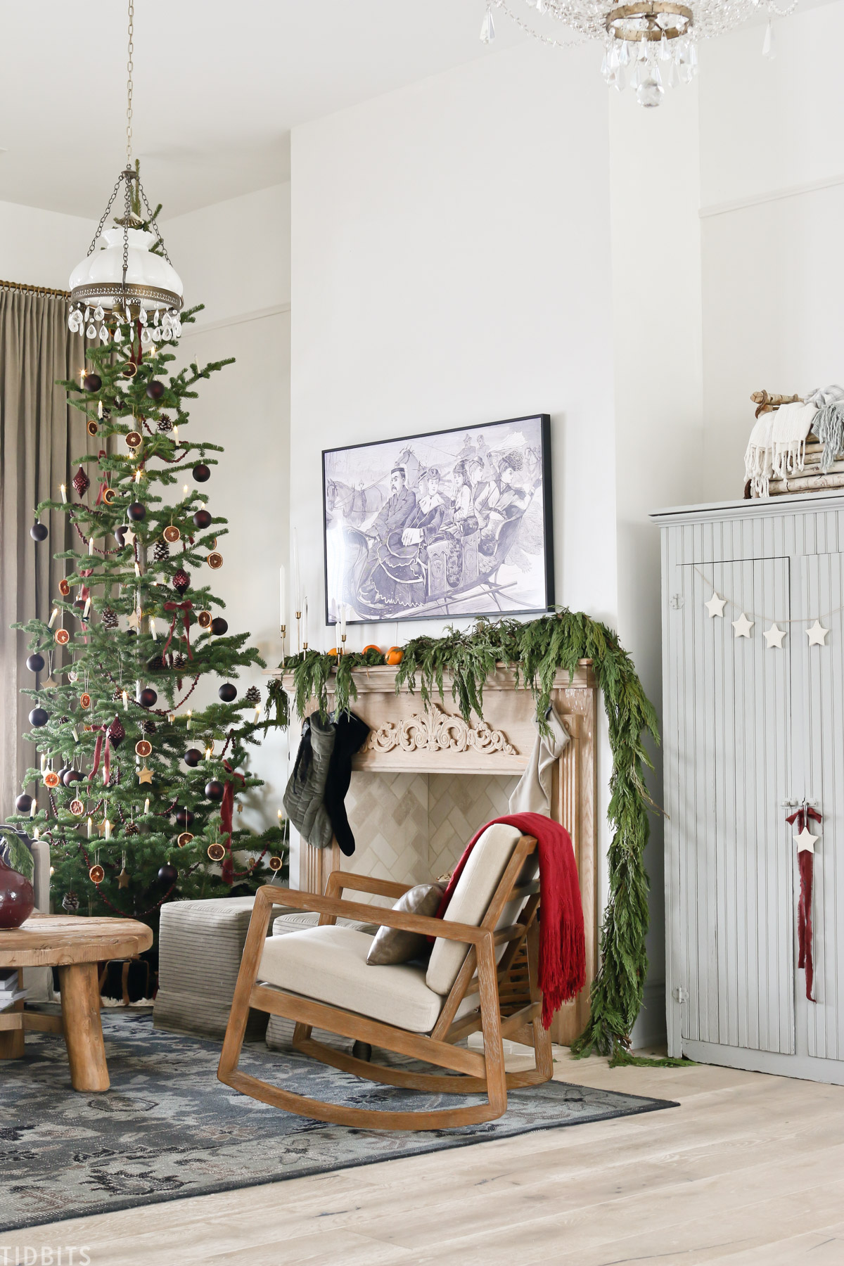 living room with European Old World Christmas decorations with arm chair, coffee table, and cabinet