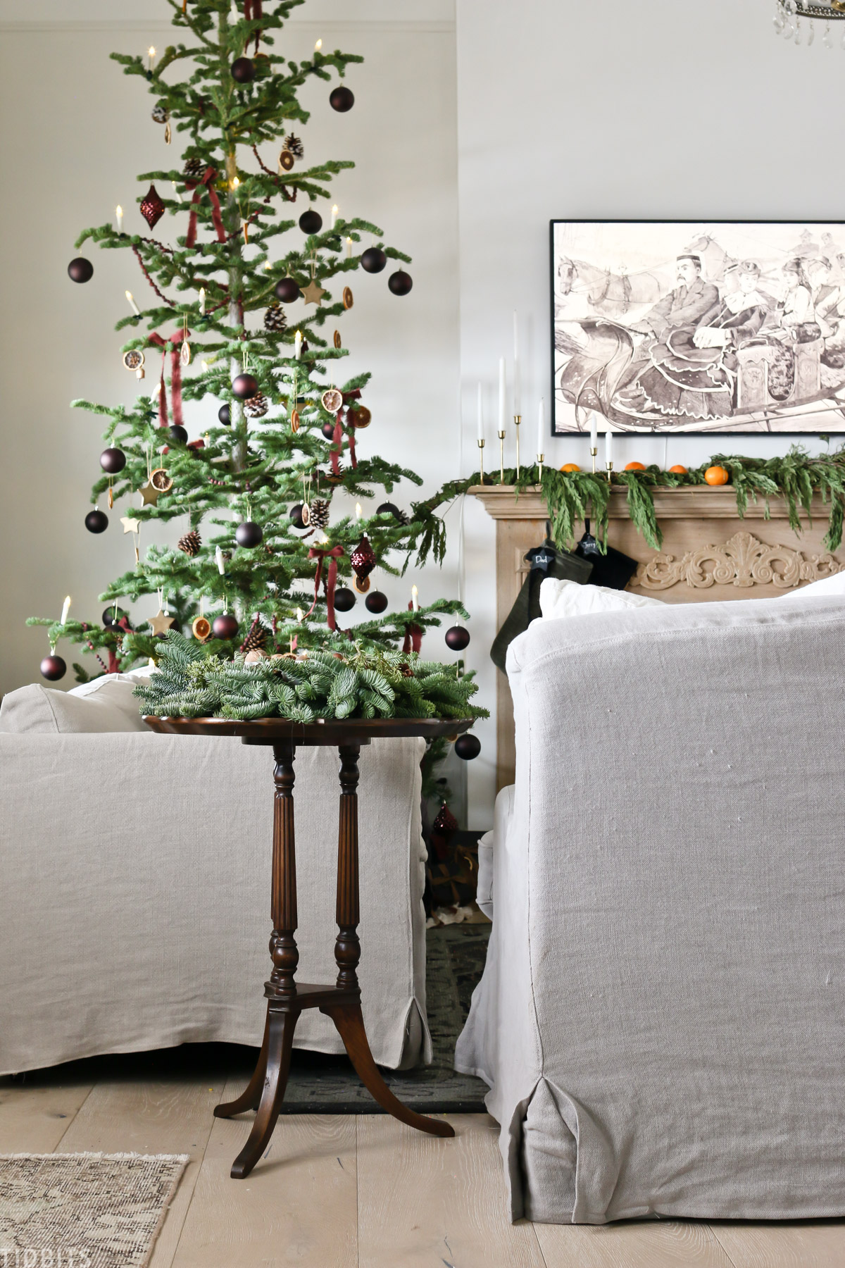 living room showing European Old World style Christmas decorations and Christmas tree
