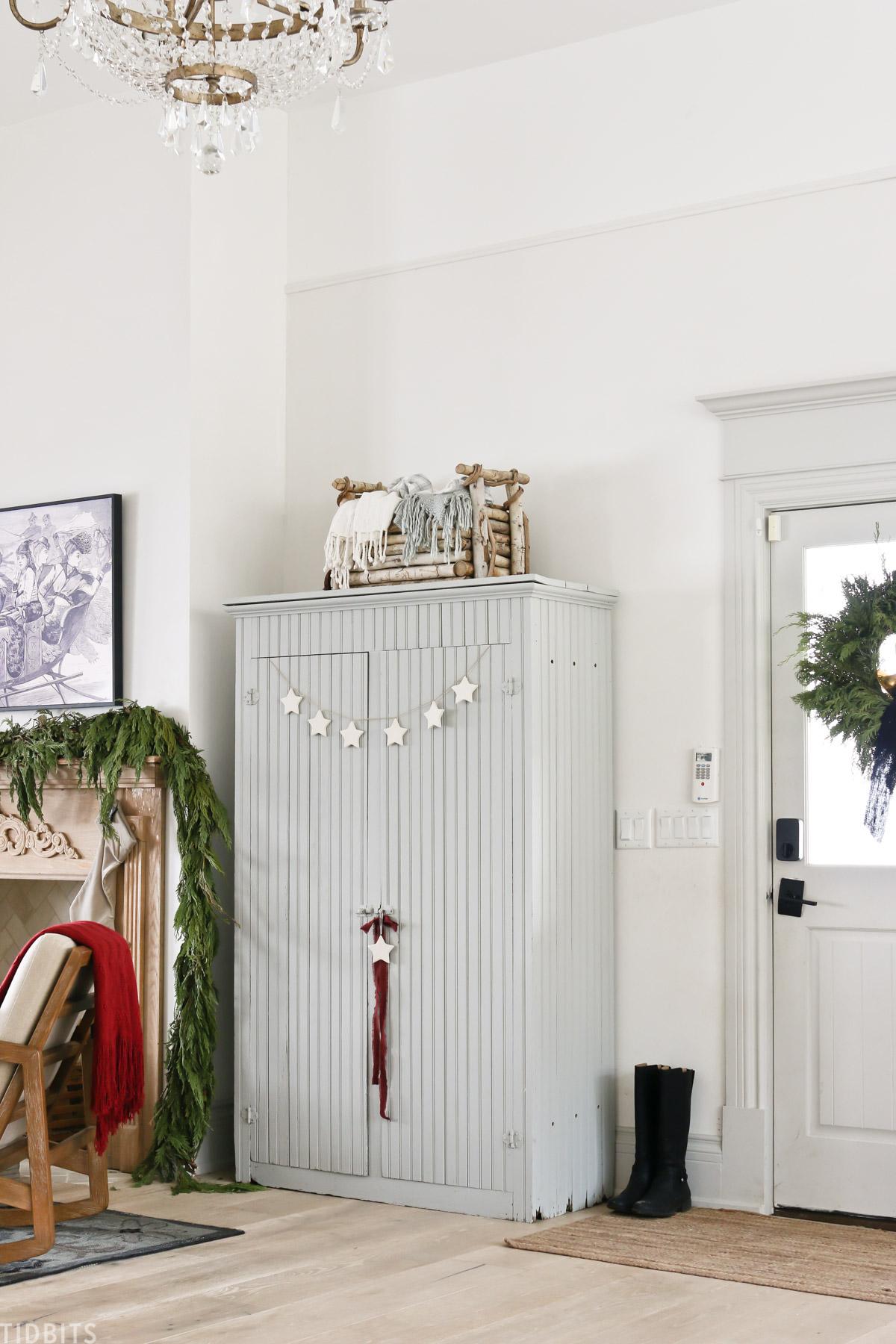 light blue cabinet next to side door