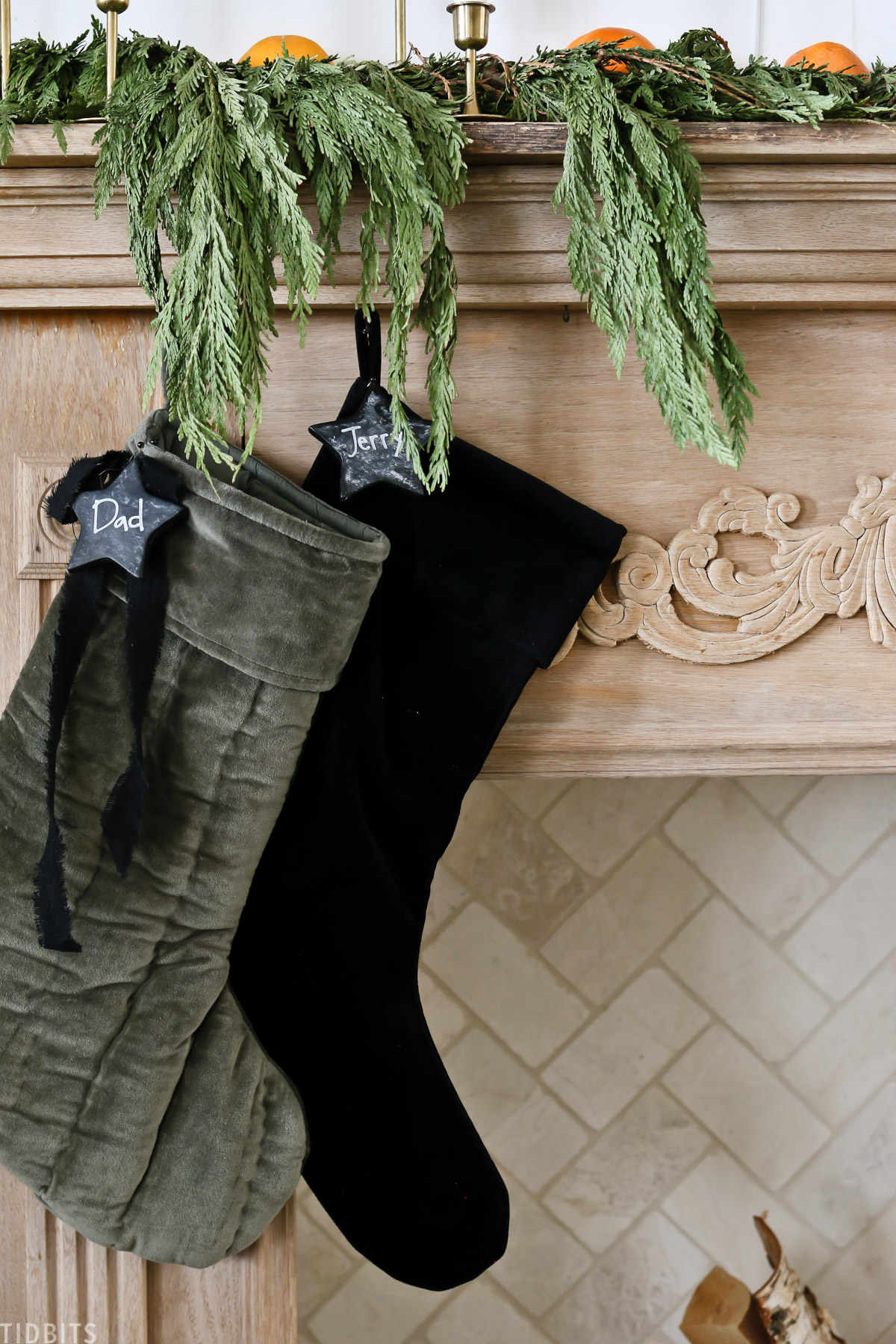 two Christmas stockings hanging from living room mantel