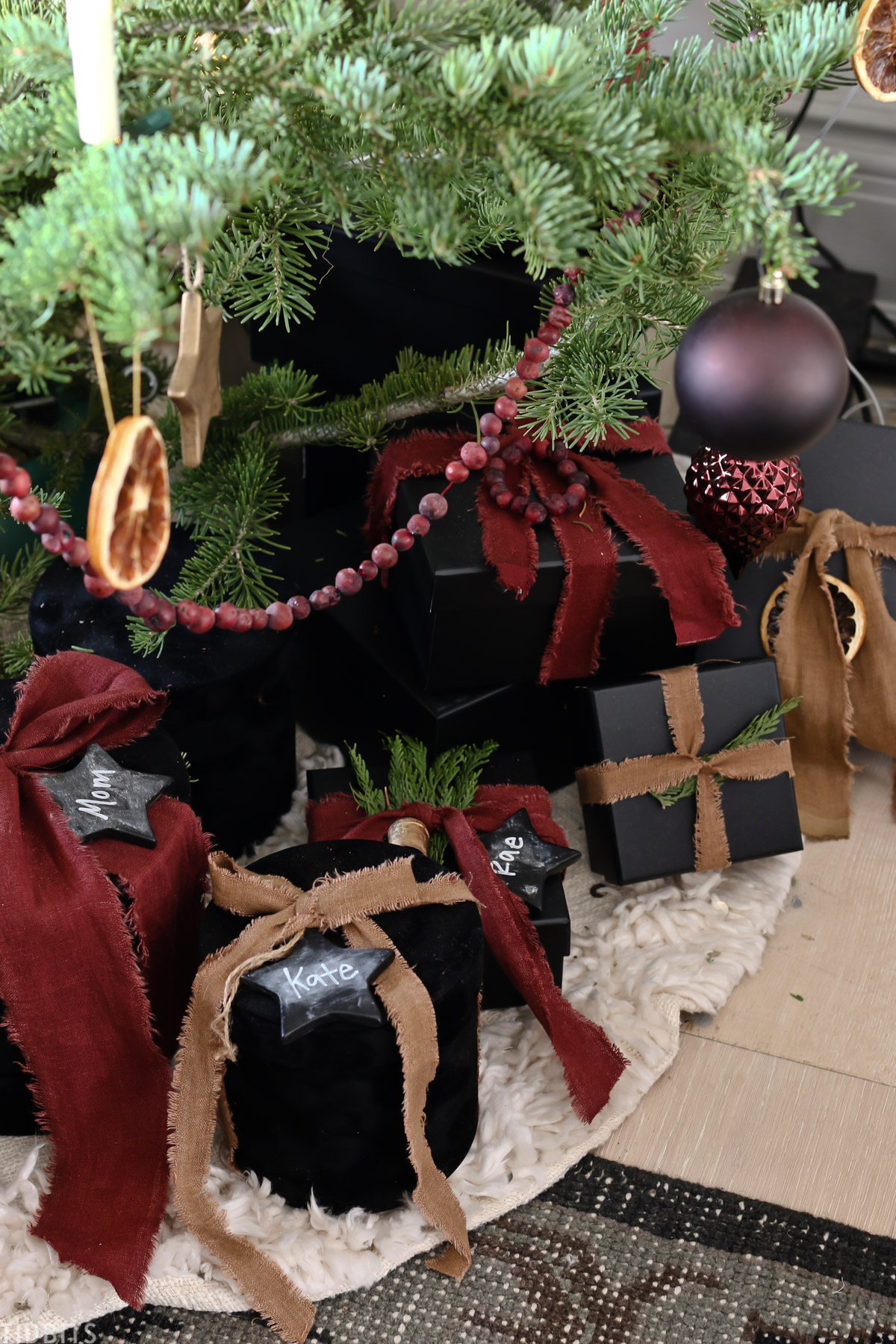 presents placed underneath Christmas tree