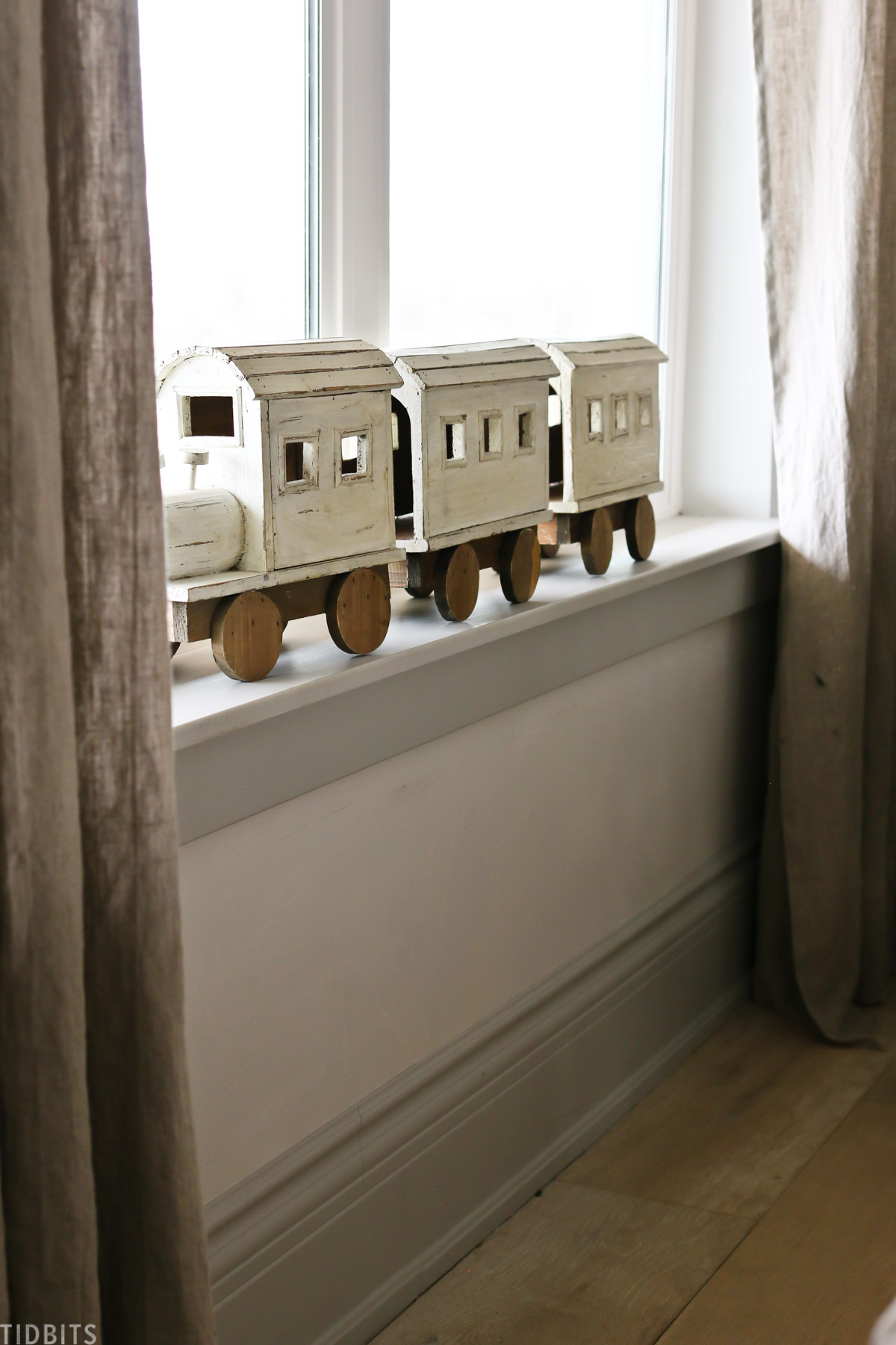 wooden toy chain placed on windowsill