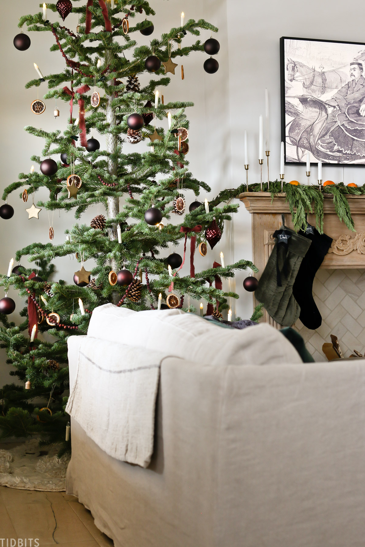 couch next to European Old World style Christmas tree