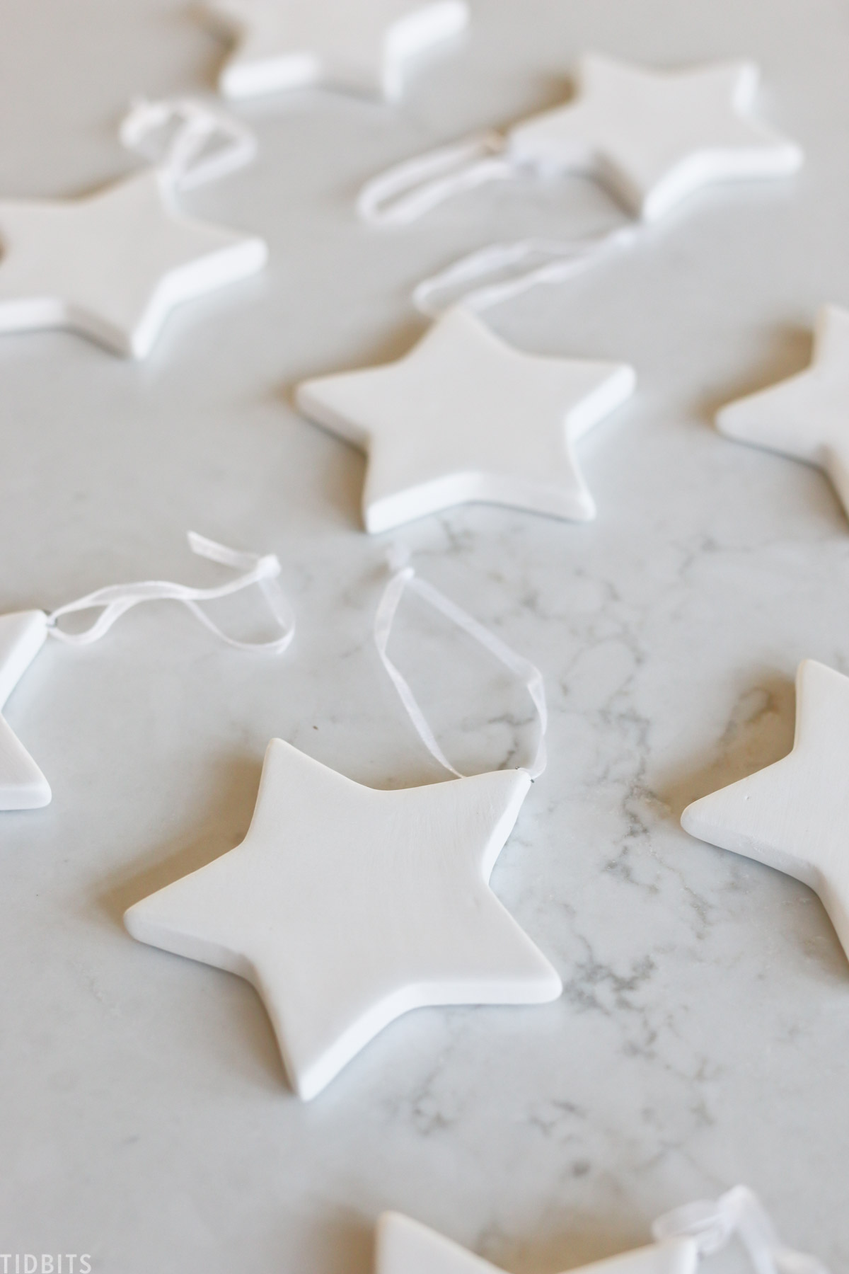 white Christmas stars laid out across countertop