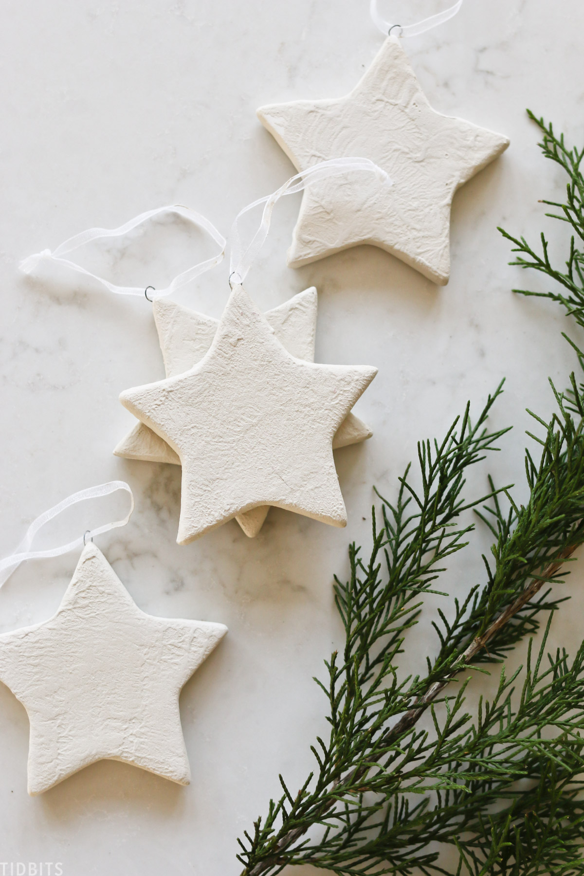 white ceramic Christmas stars laid out across countertop