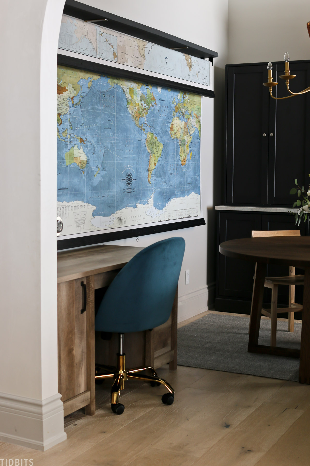 world map hanging up in homeschooling space behind a desk
