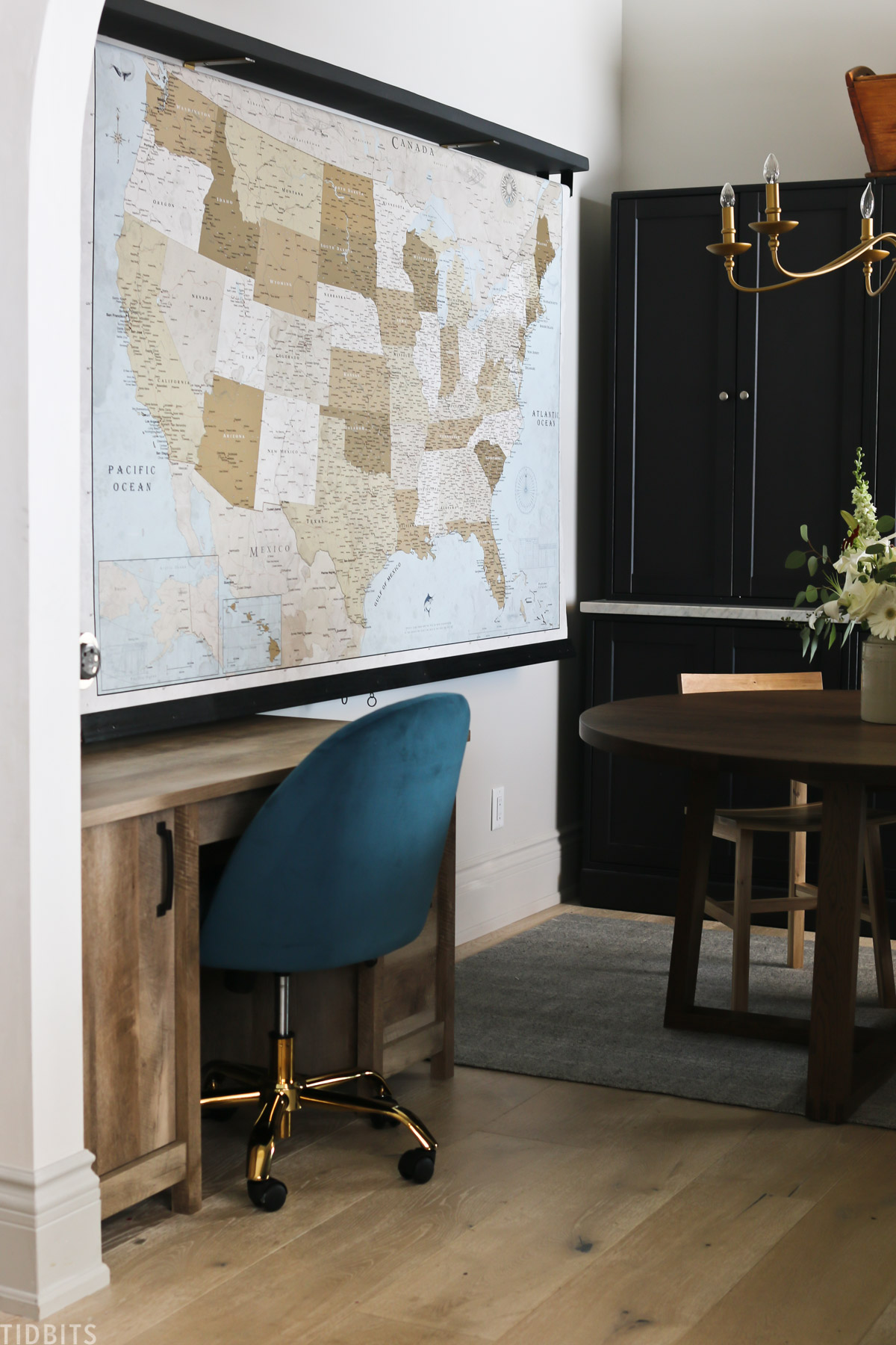 blue chair and desk placed in homeschool room in front of a pulldown classroom map
