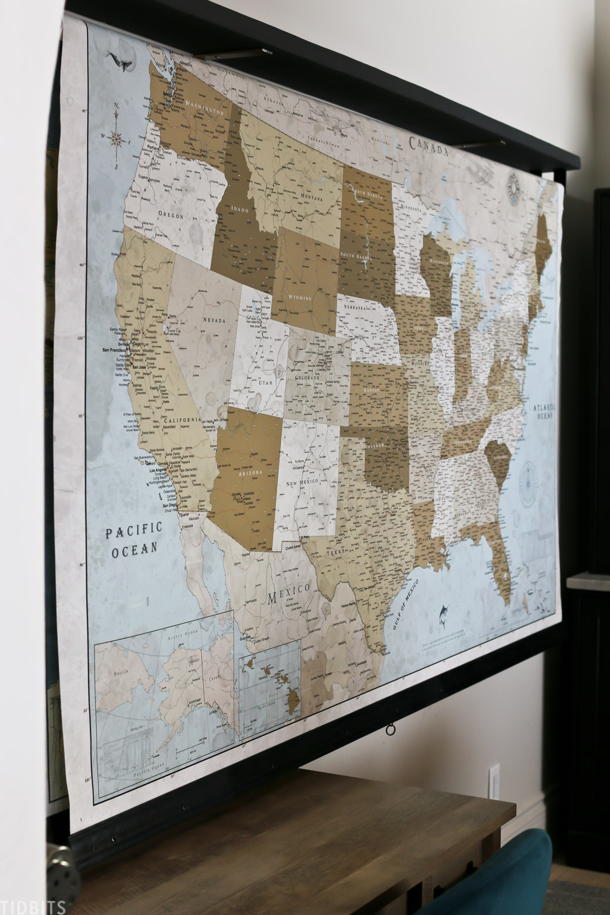 United States map hanging up in homeschooling space behind a desk