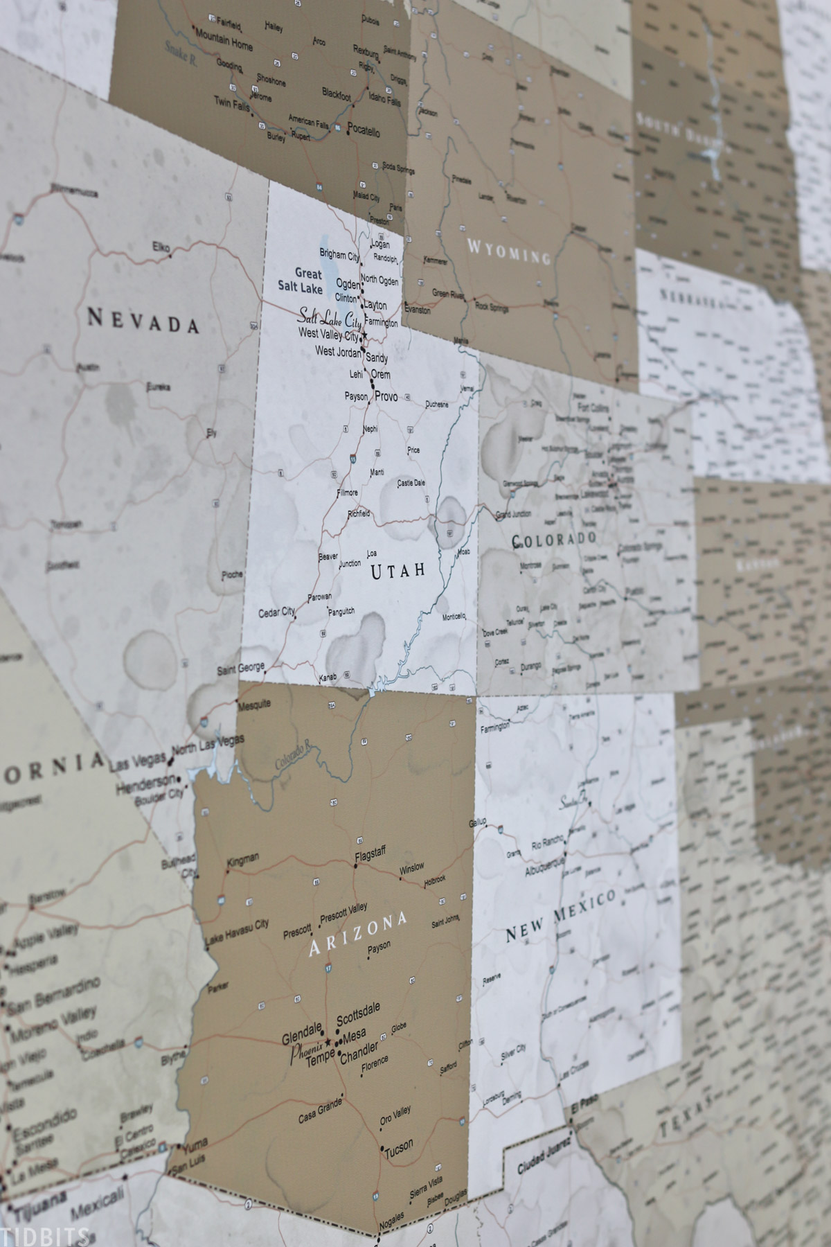 United States map hanging on wall showing details of Arizona, Utah, Colorado, and New Mexico